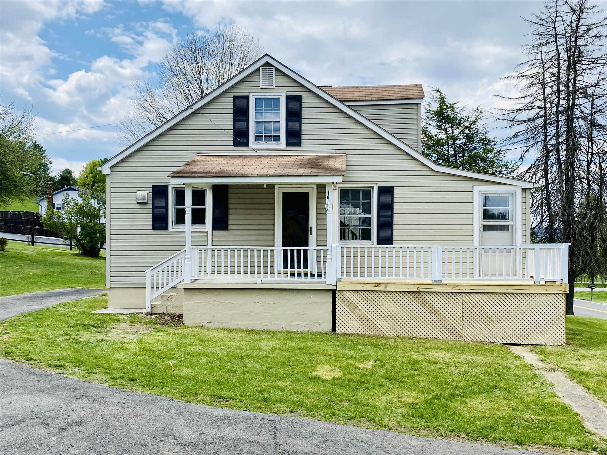 Ready to make yours. Take a look at this great new listing. Freshly painted inside and out. Updated kitchen. Real hardwood flooring. The lot is nice with a paved drive, the foundation is block, nice porches, and large open spaces on the inside. Nice yard for kids, pets or fun summer activities. Double detached garage is a plus for those looking for a workshop, she-shed or the hobby enthusiast.