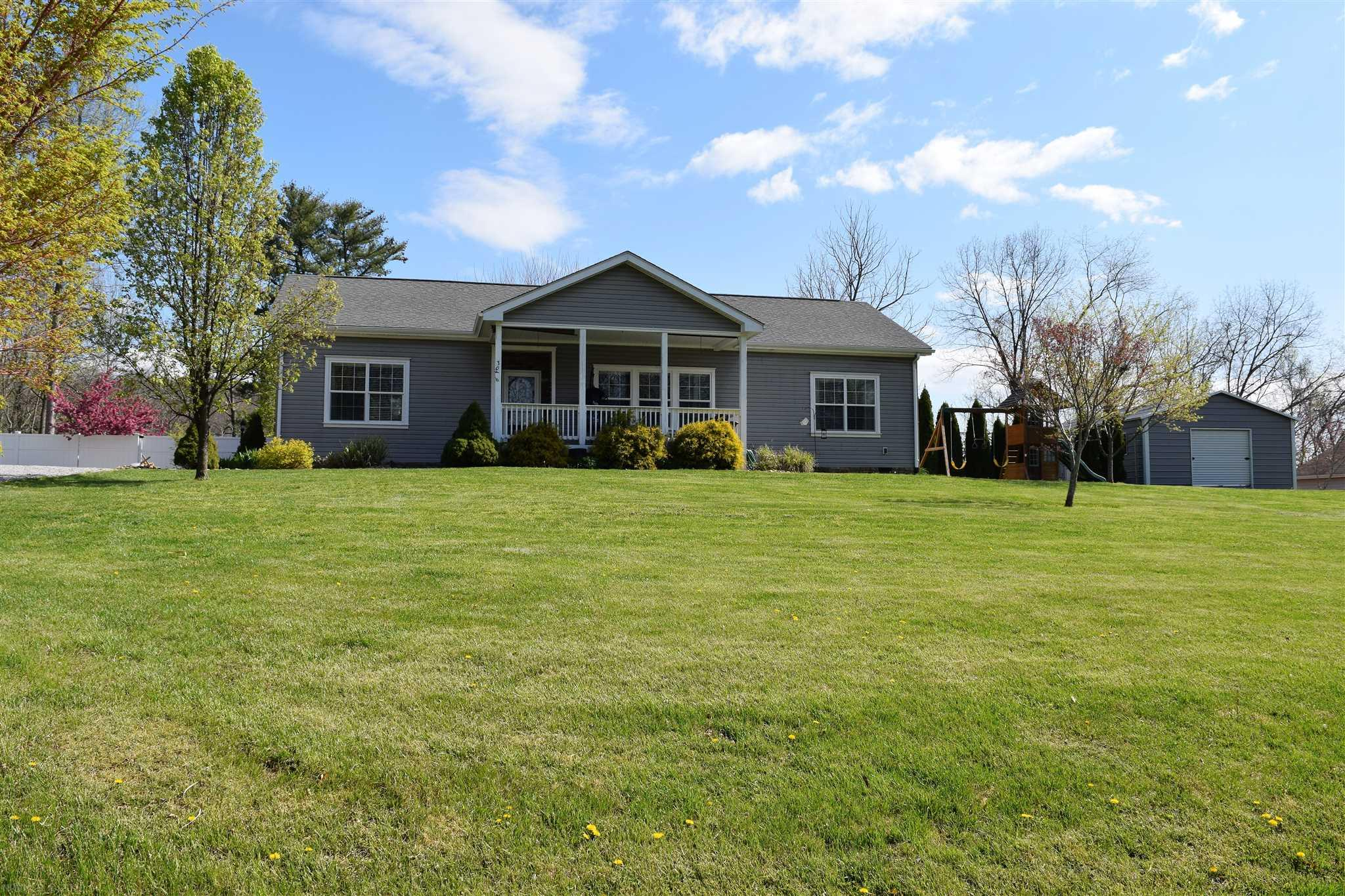 This modern ranch home offers a country setting and is only minutes away from Christiansburg, Blacksburg and Radford.  The 9 ft ceilings add to the spacious open floor plan.  This one level 1600 sq ft home is perfect for a family looking for a fenced back yard and spacious front yard with beautiful landscaping, or for the animal lover.  The back deck provides great space for entertaining family and friends as well as a fire pit to sit and enjoy the summer nights.  The detached building has cement flooring and provides extra space for storage, gym equipment, or a recreational vehicle.  This home exhibits an enjoyable outdoor setting as well as indoor and is moments from town.