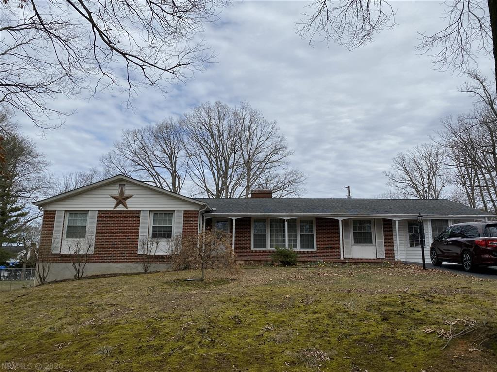This beautiful brick ranch sits on a corner lot with so much to offer. The home features a formal LR & DR w/gleaming hardwoods and pocket doors, fantastic updated LG eat in kitchen w/Corian countertops, ceramic tile flooring, tons of cabinet space & a masonry FP, bright & spacious den w/ gas log FP great for family/friend gatherings. Enjoy the lovely landscaping while relaxing in the sunroom or enjoy the fresh air sitting or swinging on the custom built gazebo. 5 person hot tub only 1 year old, perfect working condition. Tons of storage space on the entry level and in the full walk out basement.