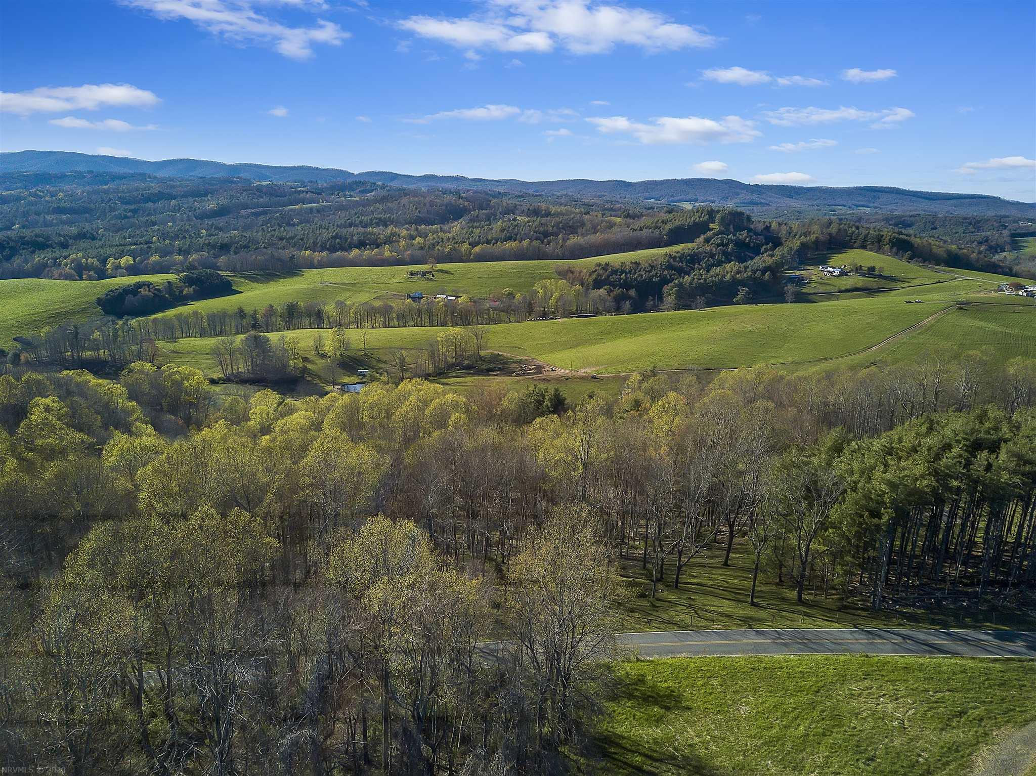 Enjoy the peaceful country setting and beautiful sunset views on this 12 ac property in Floyd County.  There is a spring on this property, and it is fenced for cattle (currently has cattle grazing on it).  It's divided into two tracts, and has great building sites on both!  You can be to the Blacksburg/Christiansburg area in just 30 minutes, or Floyd or Hillsville in just 25, making it convenient for wherever you need to go, while still being able to live in a rural setting.  Would make an excellent location to build a house and plenty of room to keep animals.  Come check it out today!