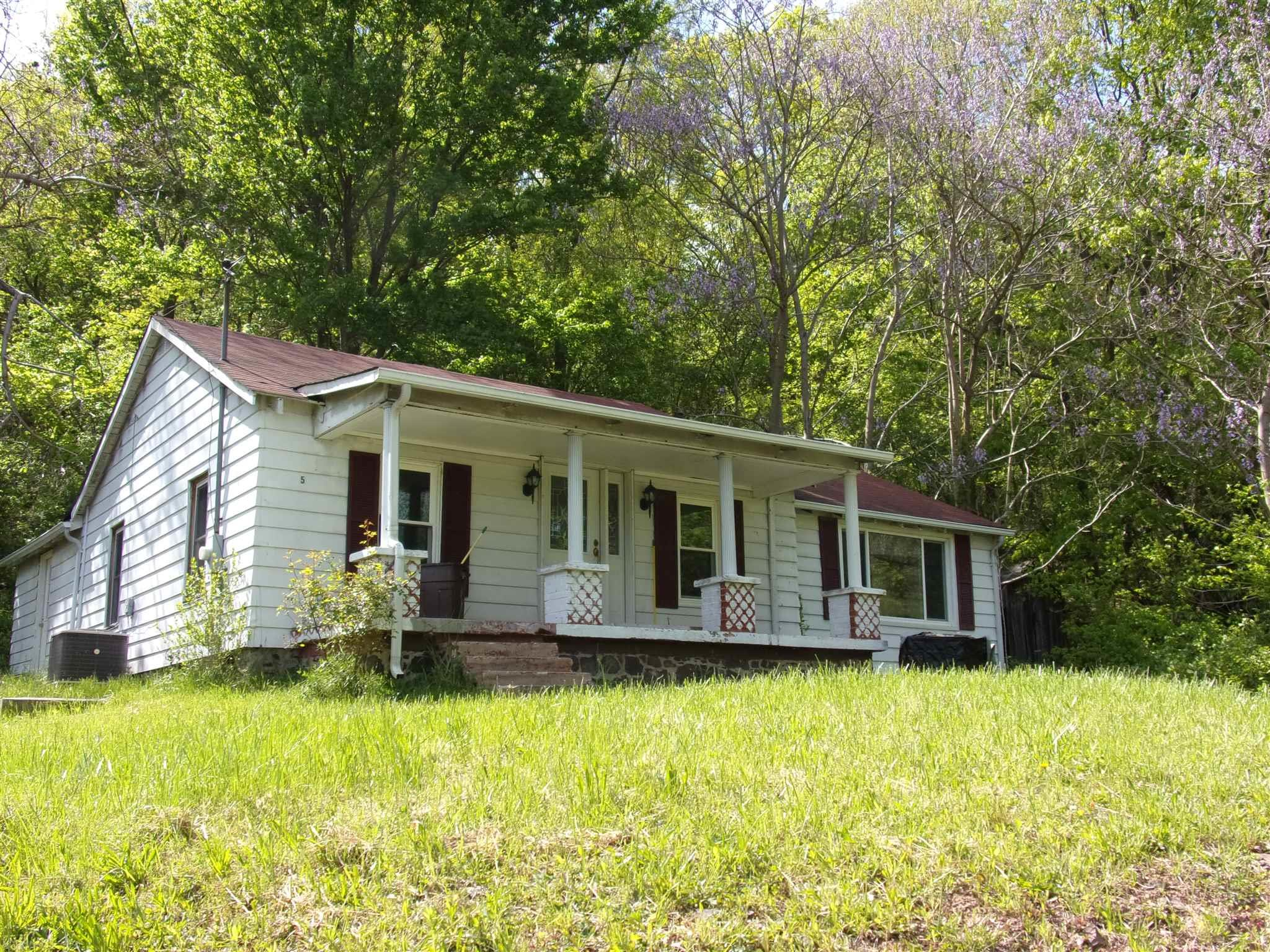 Lovely cottage style home with mountain views, this home has lots of updates, new flooring, new bathroom, updated plumbing, New Heat Pump,  if you are looking for home with mountain views in country this is it!