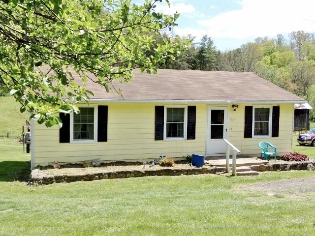 Charming home in country! Situated on approx 2.5 acres. Lovely hardwood floors in Kitchen, hall, bath & nice enclosed porch w/flue. Back deck. Nice yard. Old Barn, pole shed & block storage building.