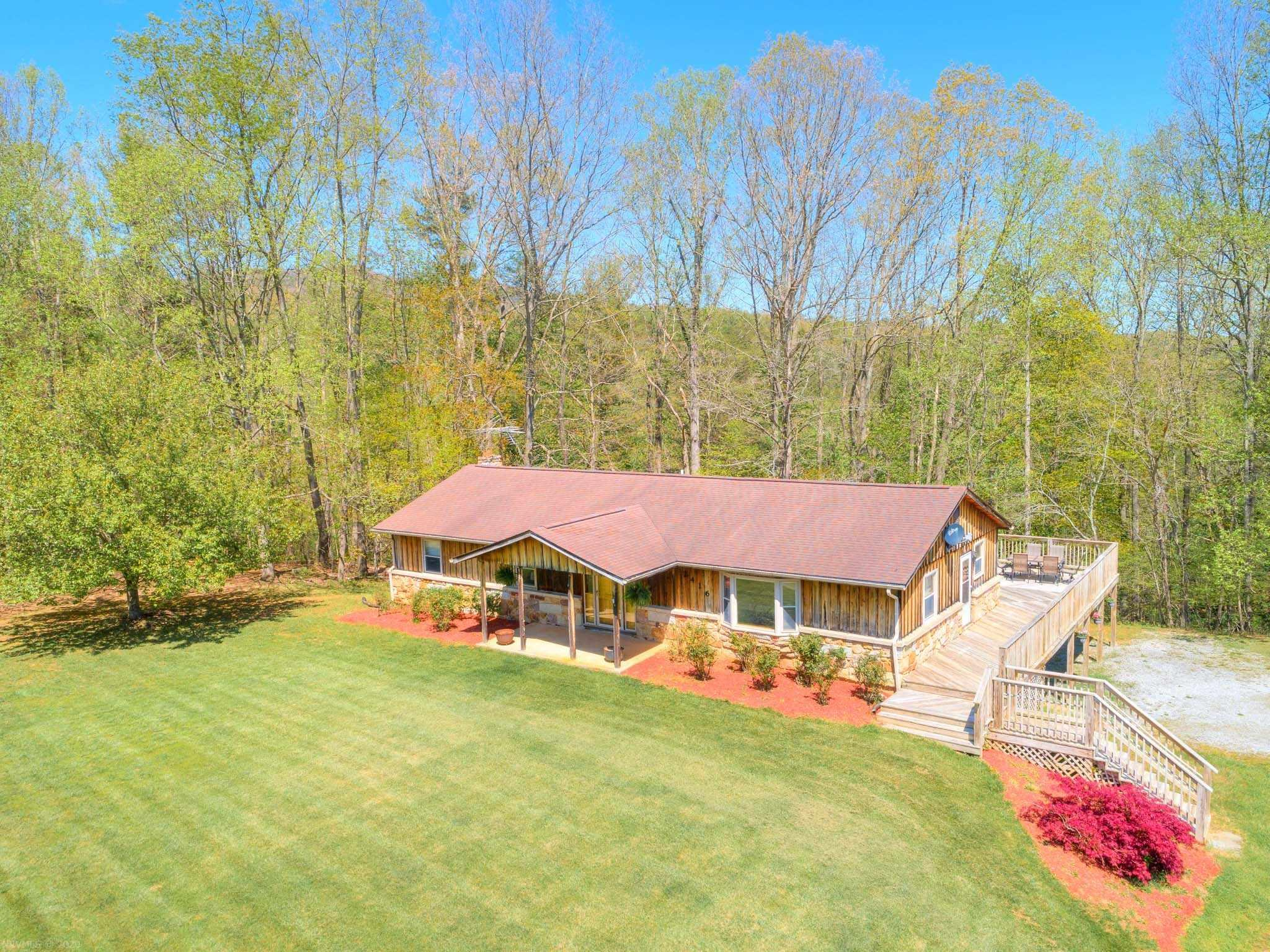 This private ranch home on over 2 acres of property is a peaceful rural retreat!  The rustic wood siding and wrap around porch, along with the beautifully maintained landscaping will catch your eye! Enter via the side door on the wrap around deck right into the kitchen. All stainless appliances, lots of counter and cabinet space. Full sized dining room with a large bay window flows right into the cozy, custom paneled living room, makes entertaining easy! The large family room/rec room on this level, also beautifully paneled, and opens onto the deck. Three carpeted bedrooms, with roomy full baths in both the hall and Master Bedroom. Master has a cedar lined wall sized closet. The basement includes the one car garage; the rest is partitioned into a partially finished rec area, laundry and utility area. Head outside for an adventure in bordering Tom's Creek, and fishing fans will want to find the trout that are released just below this property. A country living must see!