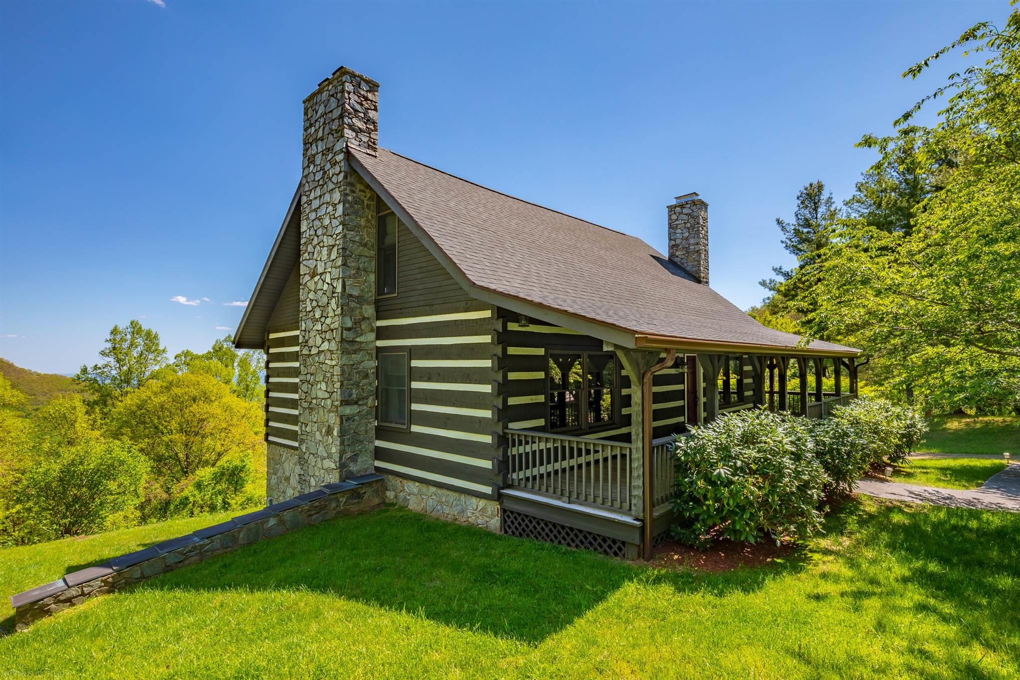 Custom Built, Hand Hewn Log Home with breathtaking Piedmont Mountain Views. Located in gated community just minutes from the Blue Ridge Parkway. Well manicured, mature landscaping gives the privacy that so many seek in the mountains. Covered porch stretches across the front and side of the house. Once inside you will be in awe over the craftsmanship that went into building this home. The living room is open to the loft above with a wood burning stone fire place at its center. The kitchen is open to the dining and living room with Granite counters, stainless steel appliances and island. There is a screened porch and large open deck to enjoy the views. Also on the main level is two bedrooms and a full bathroom. Upstairs is a loft/family room and the master suite. The oversized master has a cathedral ceiling, wood burning fireplace, full bathroom and private balcony. On the lower level is a full bathroom, bedroom, laundry room and large unfinished room with another fireplace.