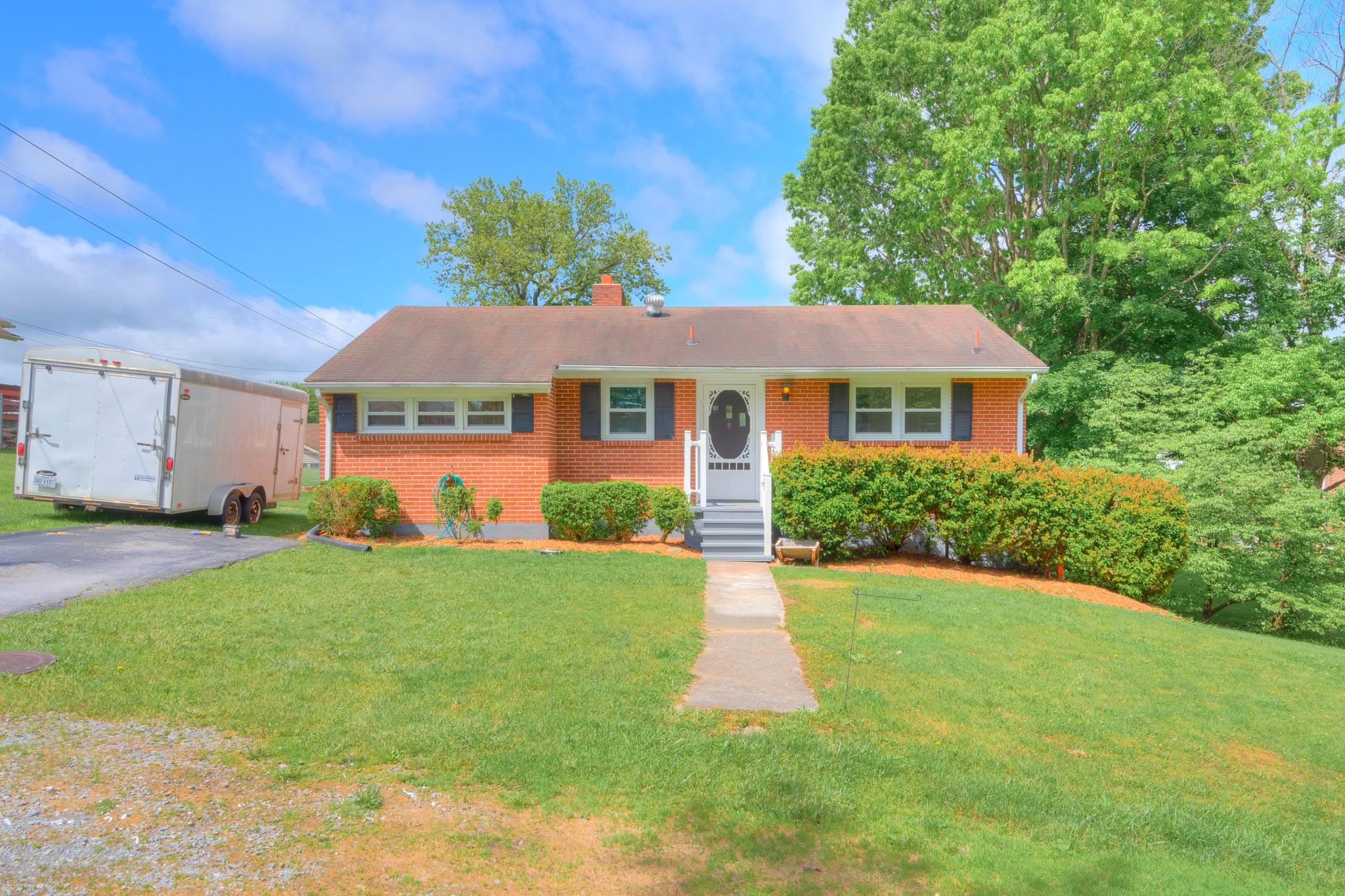Come check out this brick home that sits on large double lot. This cute home comes equipped with hardwood floors, a fireplace and a full basement with plenty of storage opportunity.