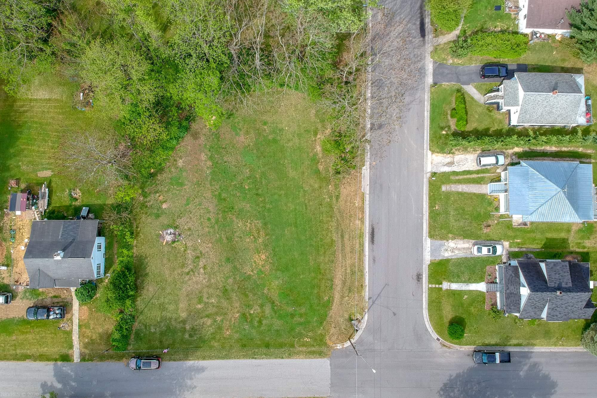 Conveniently located, cleared lot ready for you to build your dream home or a great investment. Zoned R-3 allowing for up to 3 residential units. Easy access to Interstates 77 & 81 with attractions like Big Survey, New River Trail, National Parks, campgrounds, Blue Ridge Parkway, motorcycle riding and everything the beautiful Blue Ridge Mountains have to offer! Additionally, this location has all the benefits of living in town...close to schools, shopping, restaurants, entertainment & medical care... in a quiet neighborhood. So many reasons to take a close look at this property. Town water and sewer are available.