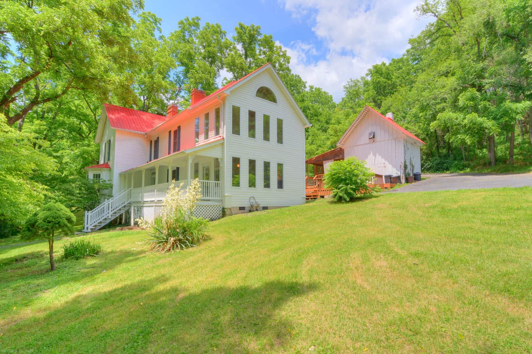 Classic restored farmhouse situated on 14 acres with Pine Creek running the entire length of the property. Filled with unique features that blend old world charm with modern conveniences including Oak and Yellow Pine floors, metal roof, vinyl siding, extensive decking, etched glass doors and 5 fireplaces. Boasting a living room and sitting room with fireplaces and the modern kitchen is filled to the brim with cabinet and counter space, plus a built-in desk, wall oven and cook-top. Laundry room and a porch complete the main level. A primary suite offers a private bath while the additional three bedrooms share a unique bathroom with two vanities, spa tub and walk-in shower. A sitting area with bath access and an alluring 2 story sunroom completed the upstairs. The newly constructed post and beam cabin / outbuilding is sure to impress! Come walk across the bridge, listen to the rippling creek and make this special property  Your Home!