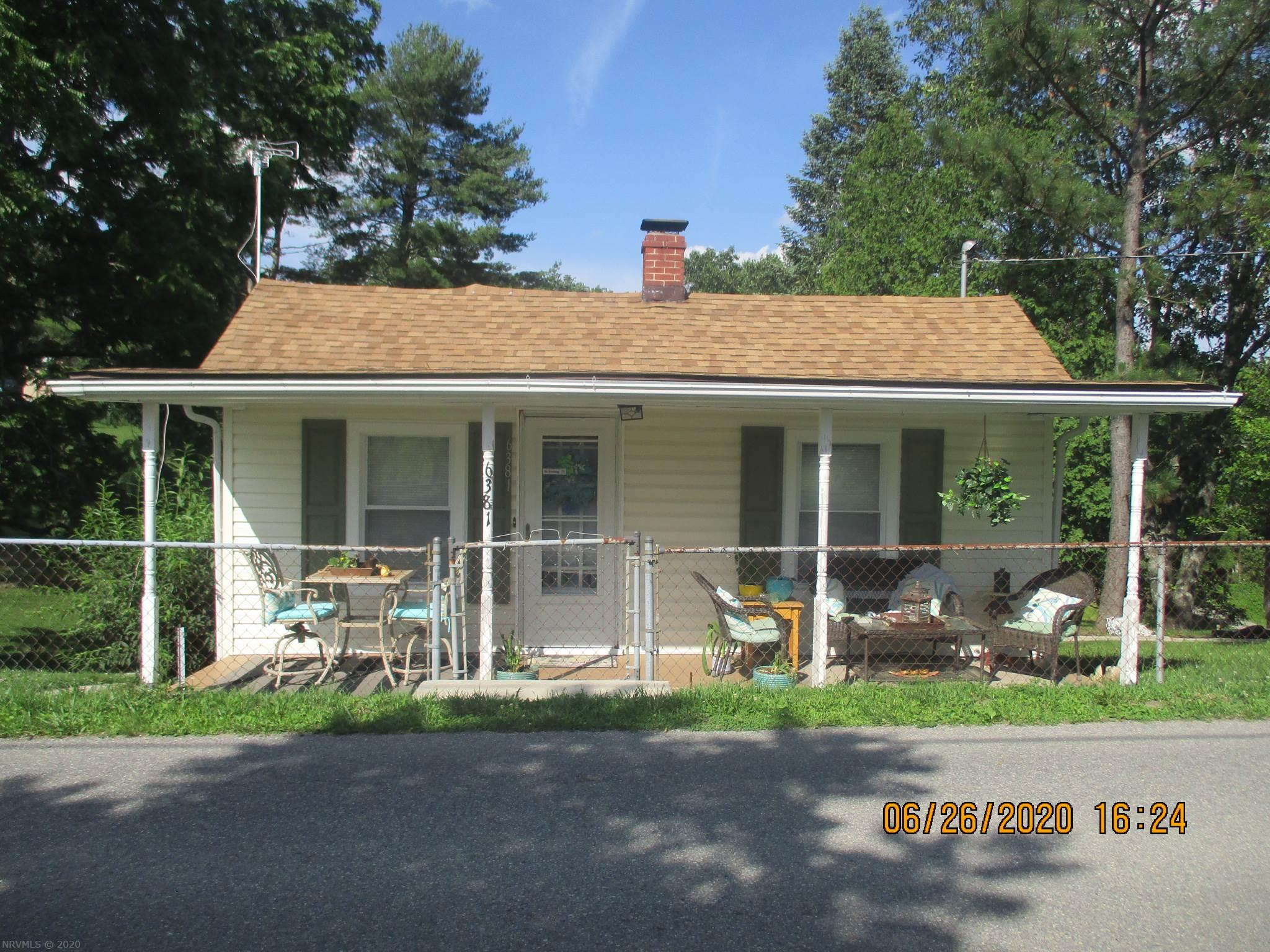 Step inside this delightful, cottage style home and you will fall in love.  The owner has totally transformed this home into a relaxing retreat.  And wait until you see the kitchen and dining area!  Three bedrooms, two baths, a living room, den and more are neatly situated in this lovely home. Newer windows and the roof is in GREAT condition. Vinyl siding and so much more! Quiet, country setting with pastoral views.  Don't miss your opportunity to own this uniquely designed home.  Call and schedule a showing today!