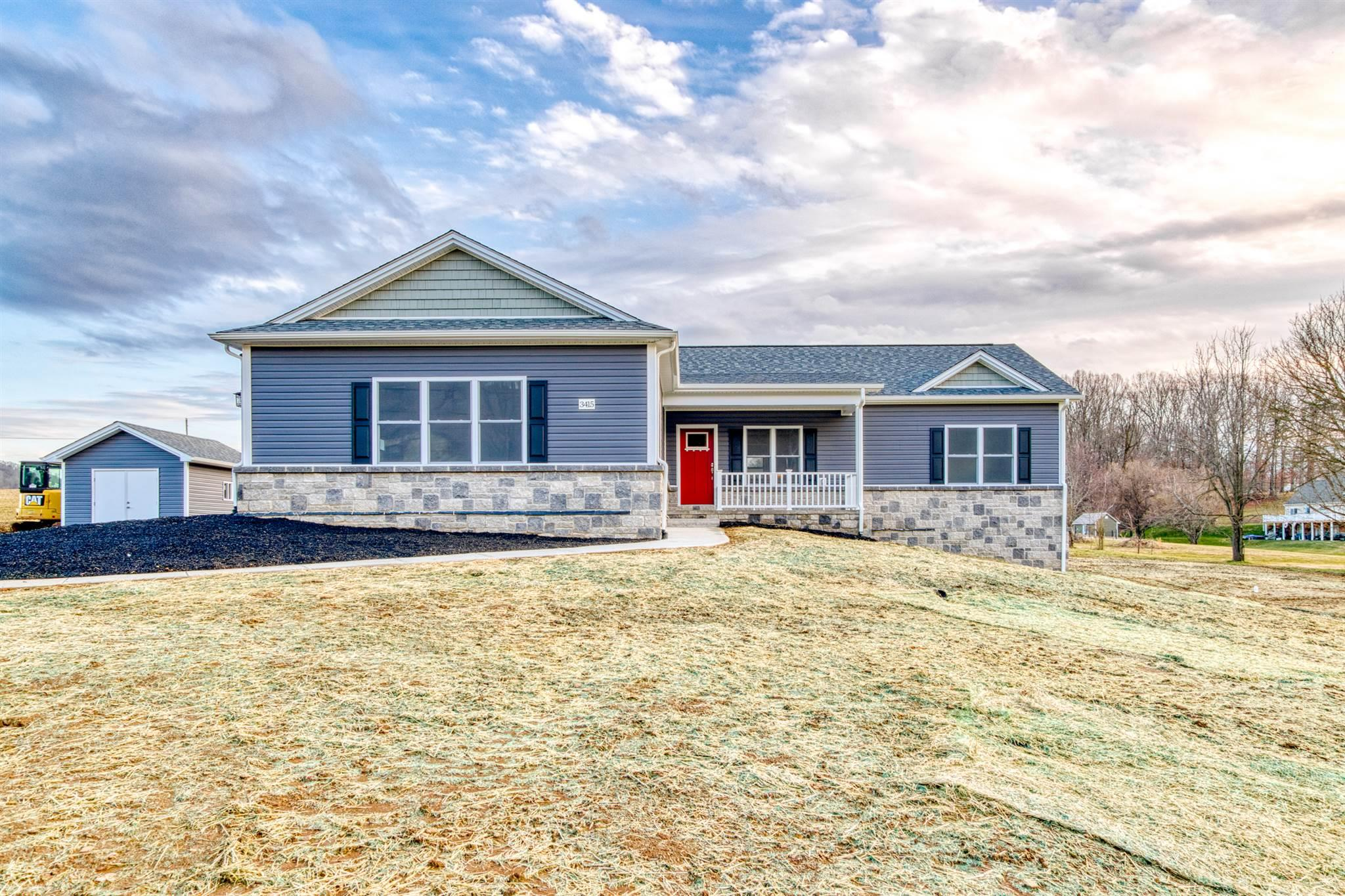 New Construction by Absolute Construction LLC. This home has a very nice open floor plan. Large kitchen with stainless steel appliances an island and granite counter tops. Beautiful sun room and full walkout basement. Also included is a 12' X 16' storage building.