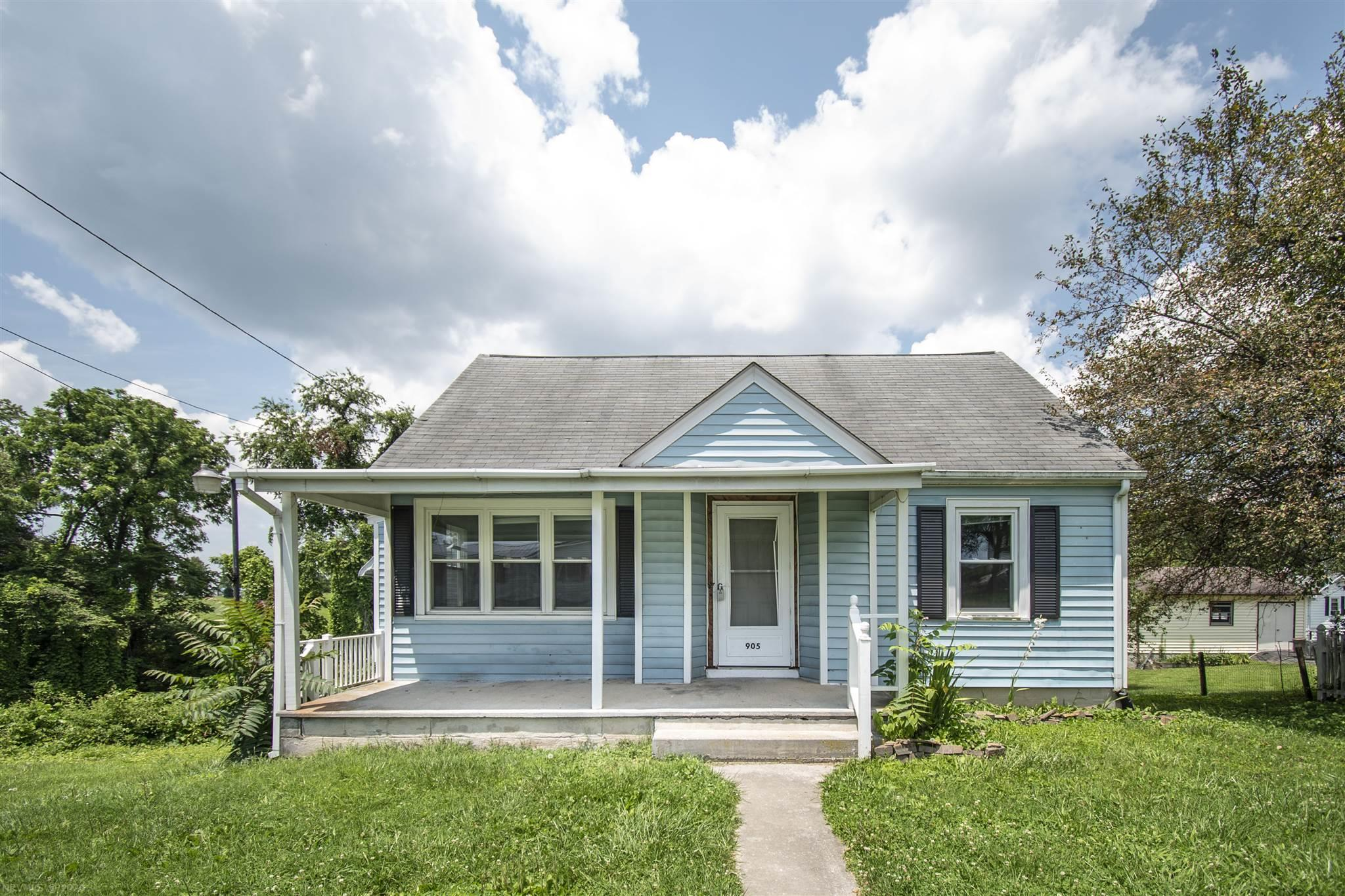 Handyman's Special with lots of Potential. Charming home with gable style roofing. Nice covered porch and finished basement.