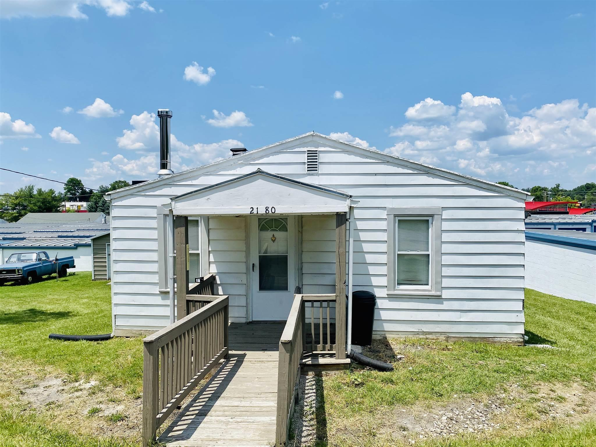 2 bedroom home with hardwood floors located on dead end street. Master bedroom with walk in closet. Enclosed back porch with laundry hook ups. Partial basement. Double detached garage with storage. This would be a great property for an investor.