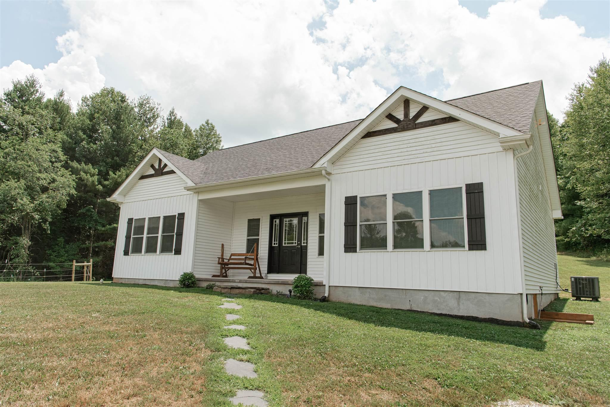 "Don't miss this beautiful ""like new"" 3 bedroom 2 bath 1-level home sitting on nearly 5 acres in Floyd County. The home has gorgeous finishing from high ceilings, granite counters, sliding barn doors, stunning master bath, high end appliances, and so much more!!  Great location for horse lovers, with fenced in acreage with a creek and 3 stall horse barn.  Brand new detached garage/shed included."