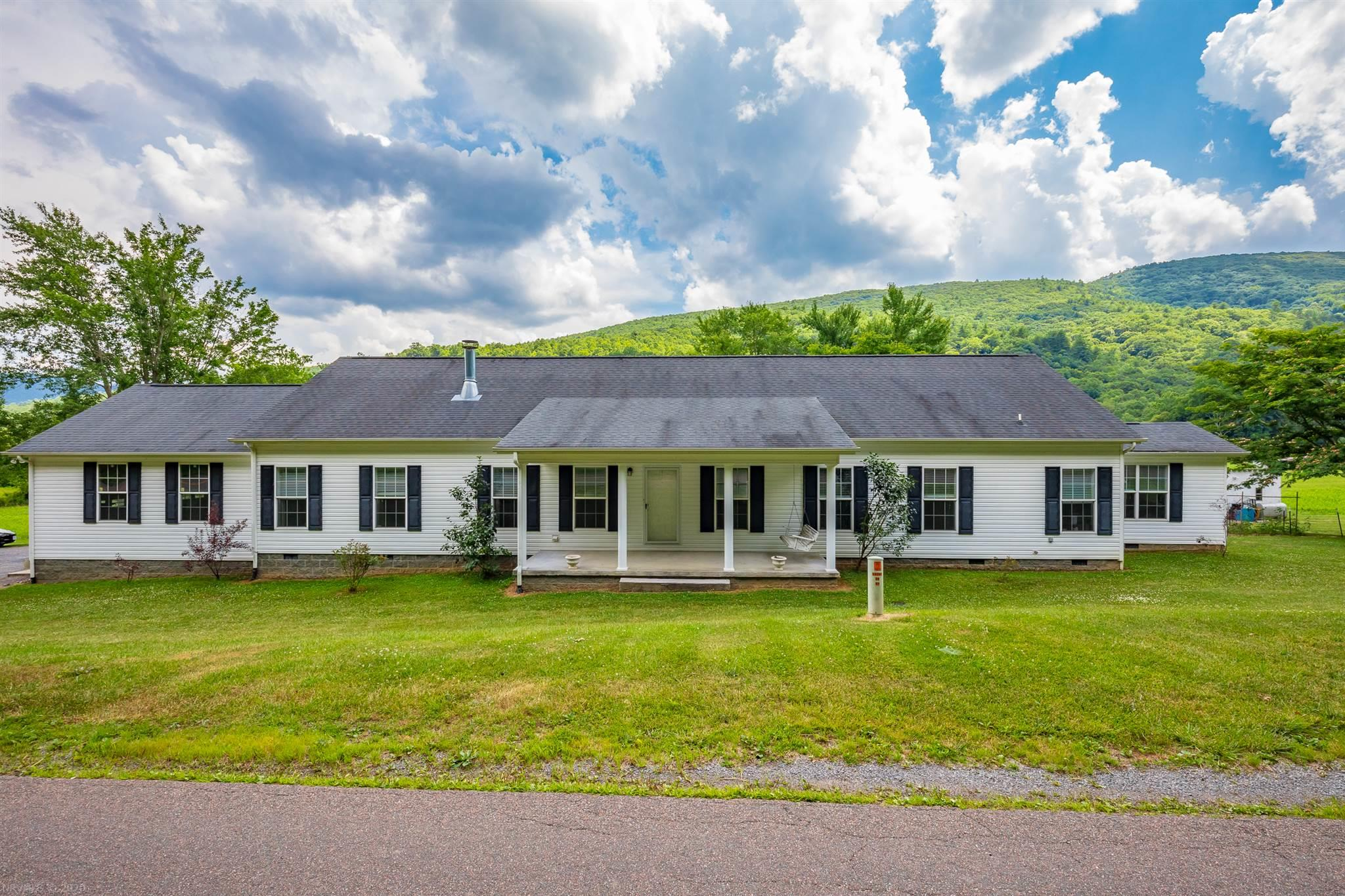 Gorgeous 3 BR 2 BA home on +/-28 acres in Bland County, VA. This property borders the Jefferson National Forest and Wolf Creek flows right through the middle of it. Great for horses, hunting, ATV riding, and more. The home was built in 2009. Very large kitchen with plenty of cabinets, a double oven, pantry, and a commercial-grade refrigerator. Entertain in front of the beautiful fireplace in the living room, which could be converted to gas if desired. The Master bedroom has its own bath and oversized walk-in closet. There is an office that could be used as a fourth bedroom if desired. Two car attached garage could also be used as a workshop. Other features include a large laundry room, a beautiful sunroom with gas logs that overlook the land, and the mountains. security system. There is a retractable 16' electrical awning on the back deck. Enjoy the mountain views and the creek view from the rear deck. Also features a spring fed goldfish pond in the yard.
