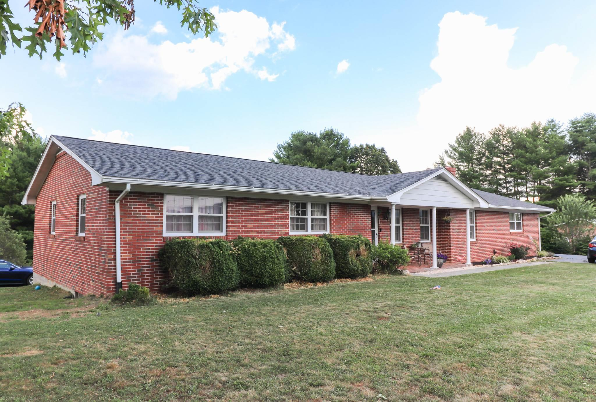 Beautiful large country brick ranch home with long range views in Floyd County. This property offers up to 5 bedrooms and 3 full baths with multi level living. Lots of recent updates making this a turn key dream for a family. Hardwood floors , custom tilework , new Hvac , newer roof , remodeled bathrooms , and fresh paint is just a few of the items you will find during your visit. Large kitchen with island is open and spacious joining the Living room. Main level laundry located  just off dining room and study.Master bedroom has on suite bathroom with standup tile shower and large vanity sink. Downstairs offers fully finished living area and kitchenette. 2 more bedrooms and full bath round out the finished basement with large rock fireplace in den and gameroom. Outside you will find joining sunroom and 2 car detached garage. Fenced in garden space and mature trees with level yard. A must see to appreciate!