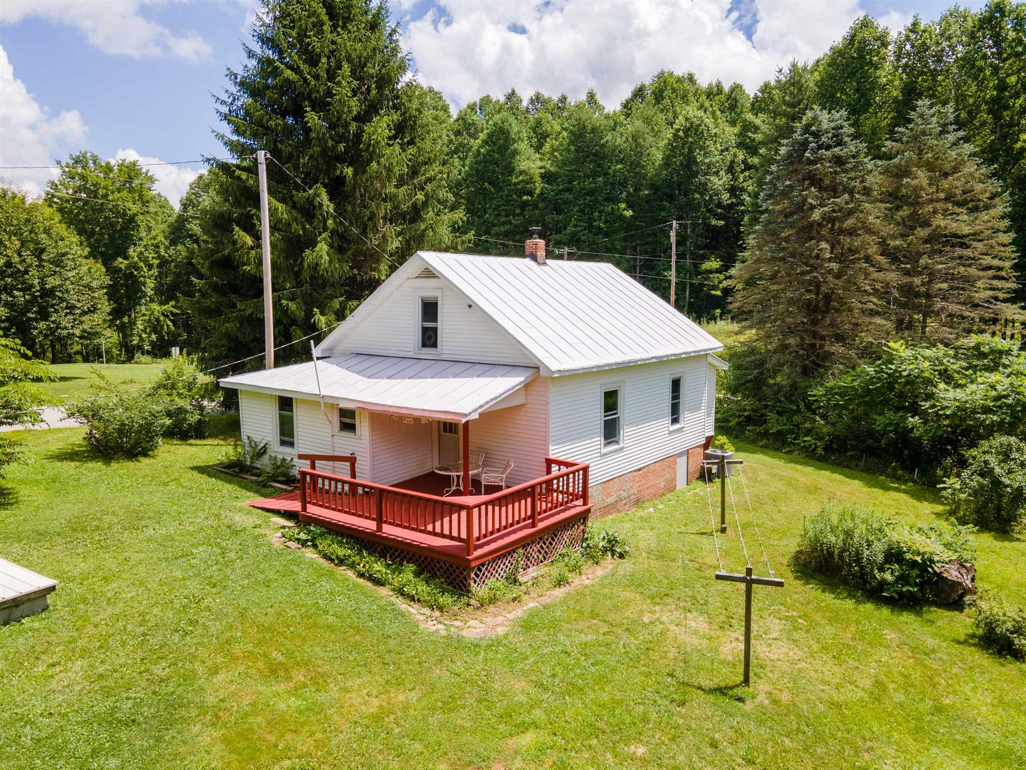 Welcome to Lilac Corner! This charming 3 bedroom, 1 bath, well insulated, Floyd County farmhouse with a spacious 10,000 sq ft fenced labyrinth garden with established, organically grown perennial medicinal plants, flowers, asparagus, fruit trees & room to add more. The property has a couple small field areas & outbuildings for farm animals & workshop.  One of the structures has a green house built onto the South side creating a great area to start seeds to prep for the season & hang out in the sunshine in the winter. Items completed in the past 5 years include: new Heat Pump with A/C, well pump & pressure tank, water supply line to house, hot water heater, interior supply plumbing, wood stove, stainless steel chimney liner, new marine coating on roof 2020. Located 1.4 mile from the Parkway close to Mabry Mill & Floyd Fest, 2.5 miles from Buffalo Mountain Preserve and in close proximity to wineries. Schedule an appointment to see this beauty for yourself!