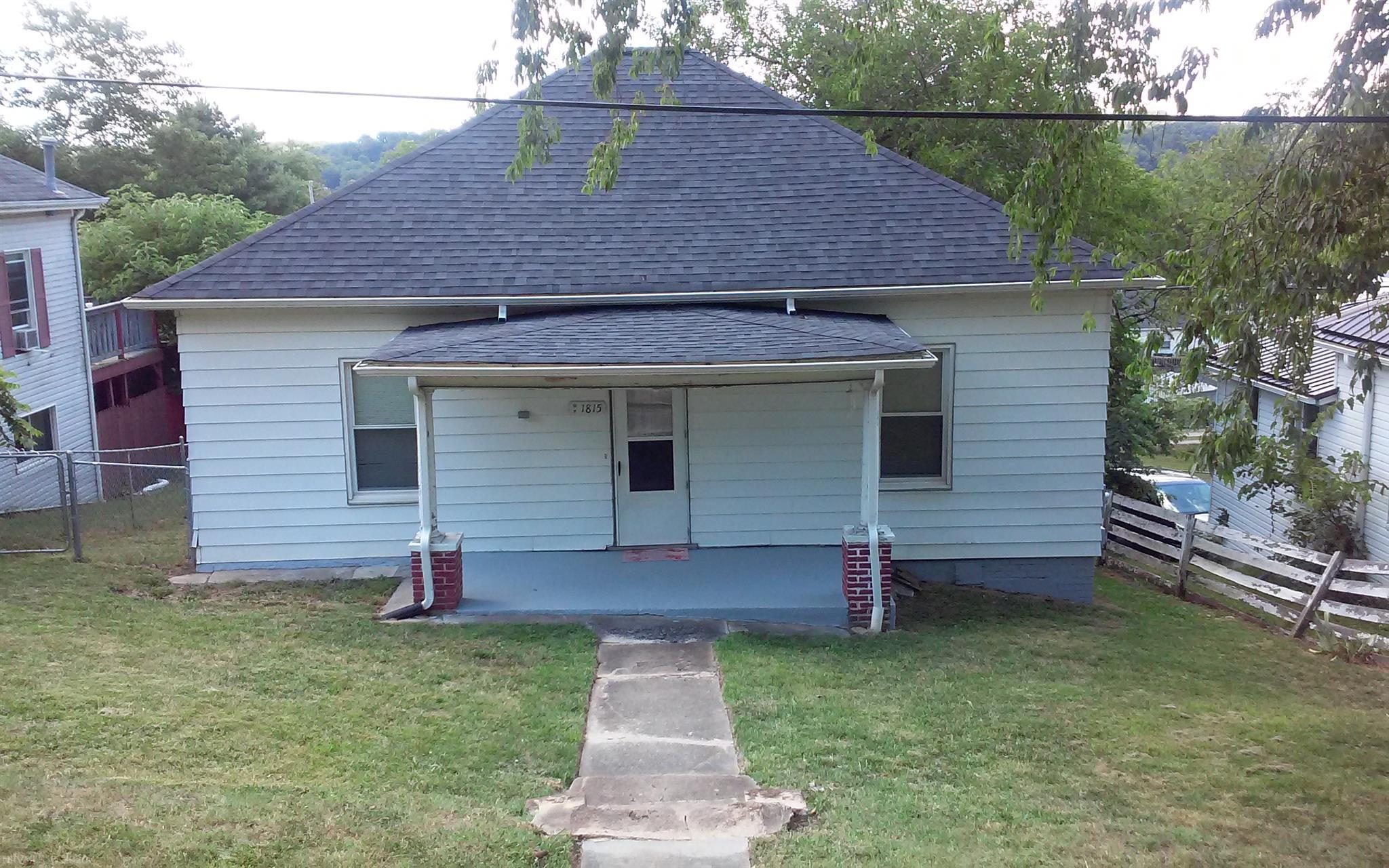 This home is a great fixer upper or flip, with replacement windows, 4 yr old roof and gutters, new paint and new electrical box and fenced in yard. With a little bit of time and money you can bring it back to life. The upstairs bathroom tub and toilet work, the sink is not connected. With 2 bathrooms a handy-person can live in it and work on it while living here. The stairs leading to basement are very sturdy but awkward at first. Basement does get water in the front right during heavy rains. Priced below assessment. Won't qualify for any Govt. loans. House sold As-Is. Inspections for discovery only. No repairs to be made by seller.