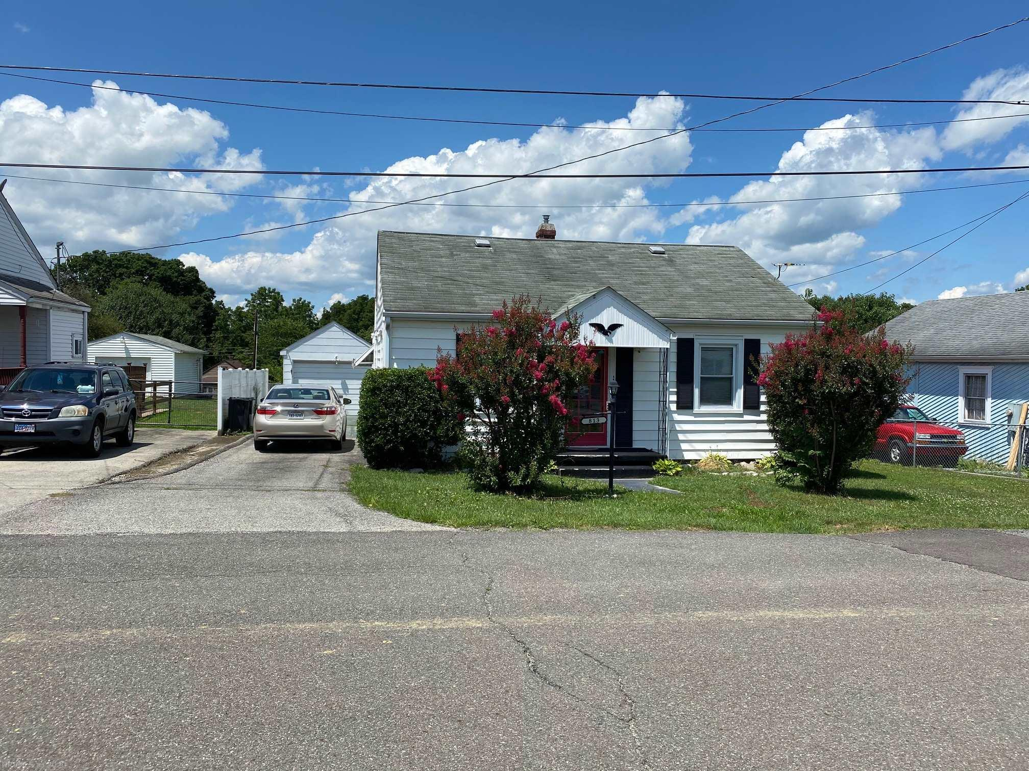 Perfect Starter Home or Investment Property.  Needing a great Garage Workshop or Extra Storage you'll love the over 400 sq. ft. of space. Living Room Chair and Couch Plus TV  along with area carpet included.  New Hot Water Heater.  Remodeled Bath. Home being sold in as is condition. Priced under Tax Assessment. Disclosure: Heating and Cooling System operative however past normal life span.  Roof also will need replacement soon.