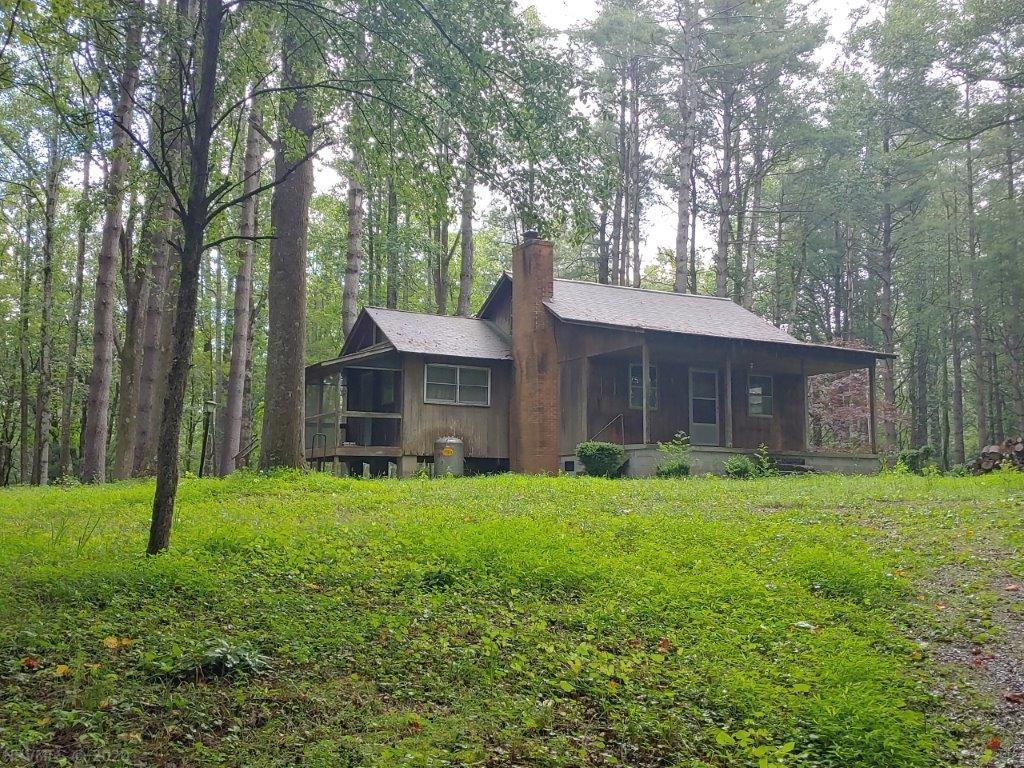 This secluded cabin sits on 3 acres in the mountains of Floyd County, VA! It includes 2 bedrooms, 1 full bath and 972 square feet of finished living space. The quiet, country setting of this property is hard to beat as it is bordered by the Blue Ridge Parkway! Spend all of your free time here surrounded by nature.