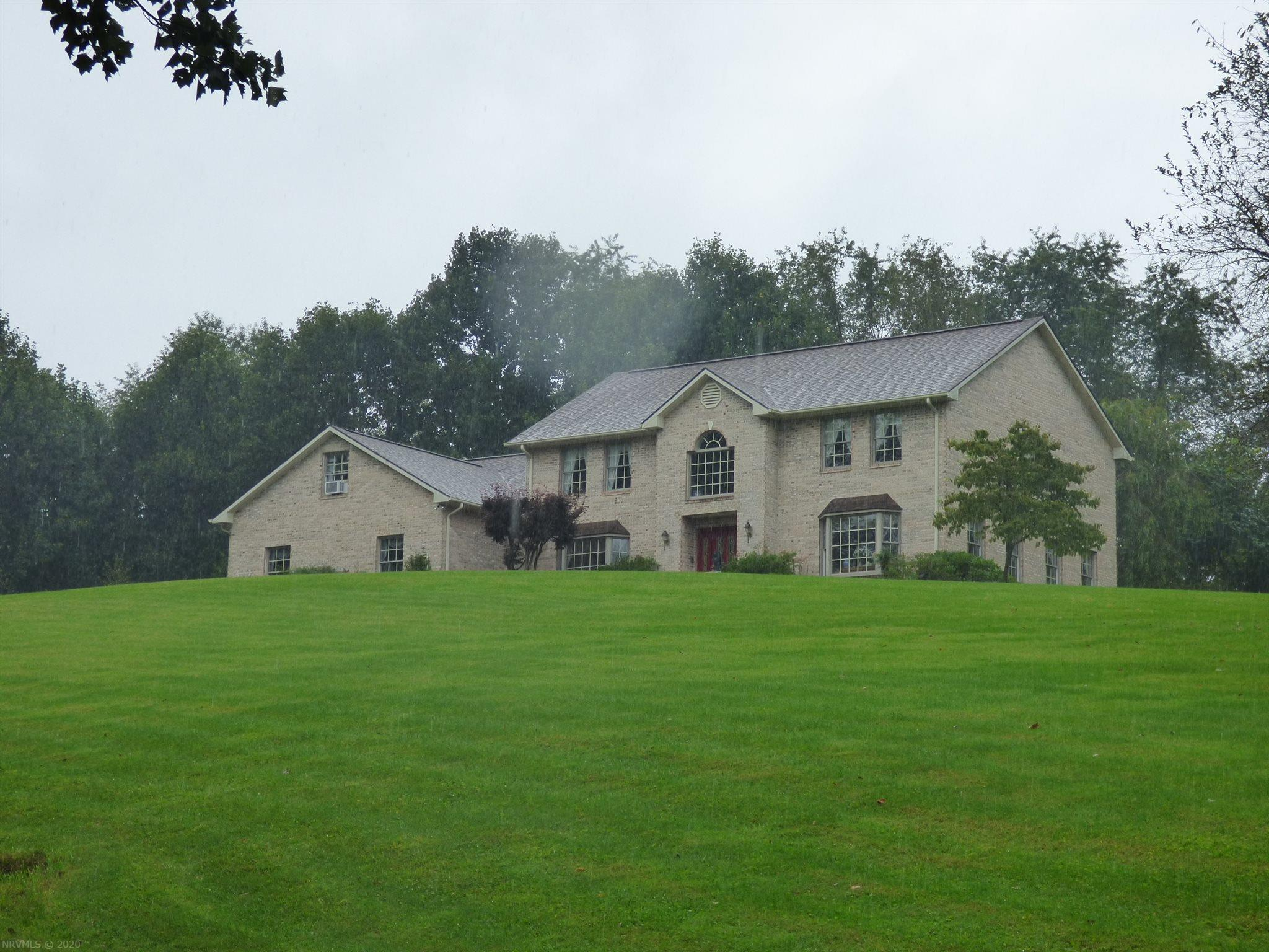 Stunning custom home with open floor plan, lots of custom features. 7 acres with amazing views.
