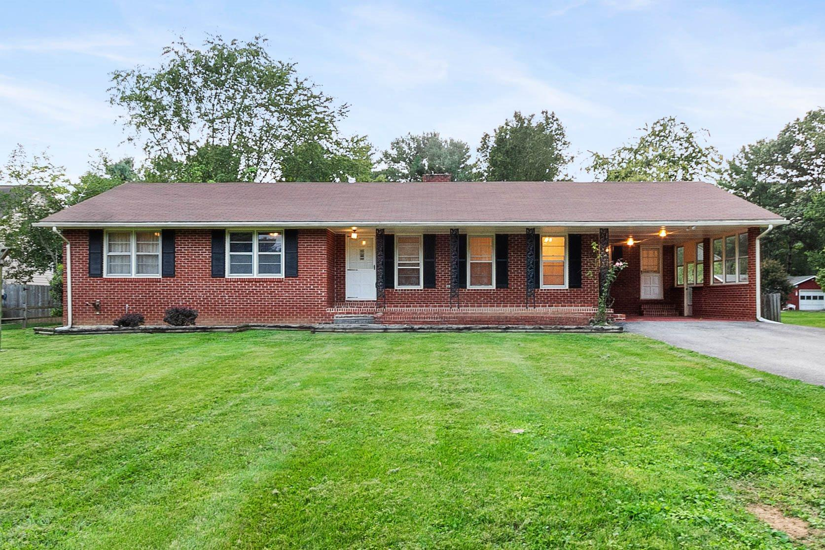Nice 3 bedroom, 2 bath Brick Ranch with a partially finished basement, paved driveway, and carport.  Formal Living room/dining room, eat-in kitchen, and a family room with brick fireplace.  Sun-room off the family room that opens onto the deck. Mature trees on a flat 0.57 Acre lot with a storage building.  Priced Under Tax Assessment! Heat Pump December 2013, Roof August 2012, & Updated 200 amp electric box and wiring. Ducted Wood Furnace, too.   Conveniently located between Christiansburg/Blacksburg and Salem/Roanoke.