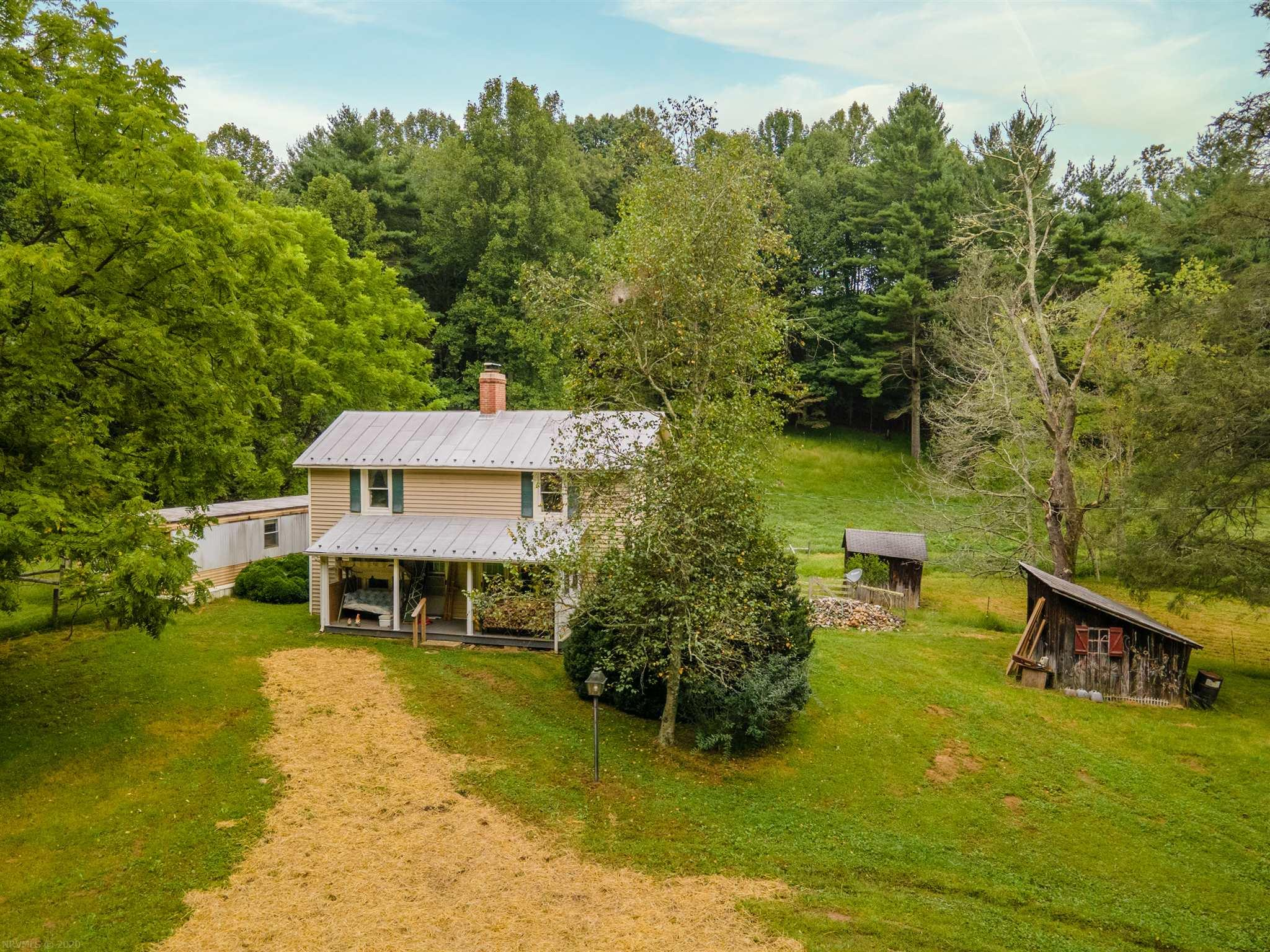 Picturesque setting with farmhouse, old barns, and outbuildings.  This farm has it all, creeks, views, substantial fencing, and mixture of pasture and woods.  Property is full of character and abundance of wildlife.  Just see the photos to understand the sheer beauty of this Floyd County Gem!