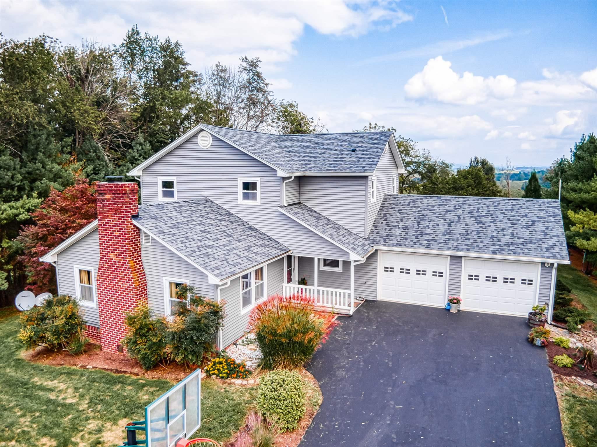 • Extremely Well-Maintained App. 2,674 Sq. Ft.  – 4 BR – 2.5 BA Home; • Mini-Farm – 5.479 Acres – Fencing, Barns, Automatic Watering; • Tree-Lined Newly Sealed Paved Driveway; • NEW: Roof, Siding, Deck, Patio, Flooring, Interior Painting, Countertops,          Backsplash, And Many More Updates!! • Vaulted Ceiling, Exposed Beams, Fireplace, Laundry On Main; • Nice Finished Basement, LOTS Of Storage!!