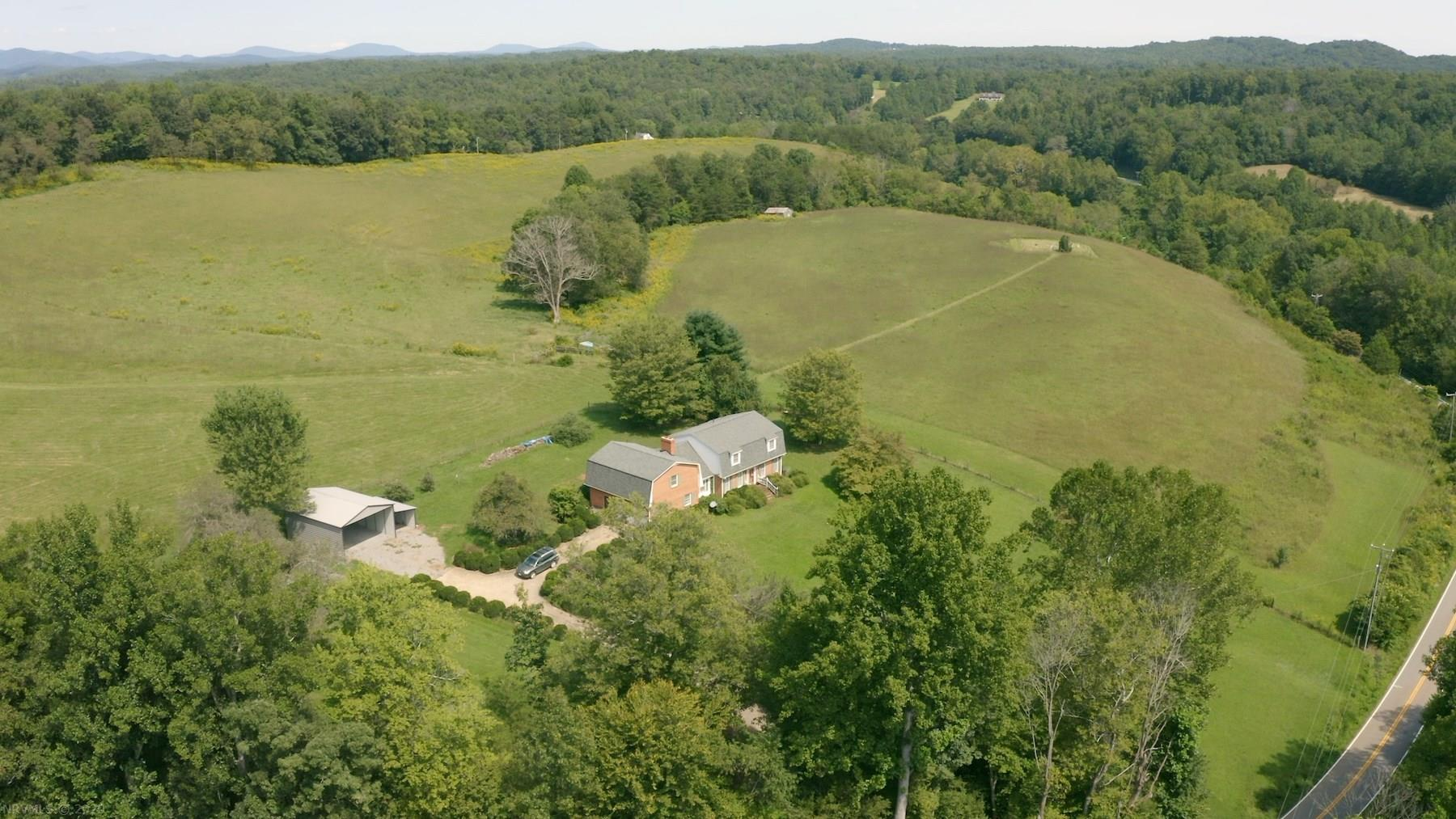 Online Only Auction! - Bid now through Oct 15th @ 4PM.  Preview dates Oct 3 @ 10 AM & Oct 8th @ 4 PM. Price is tax assessment of house tract, not reserve. You have the opportunity to purchase a beautiful farm for sale in Stuart VA. This farm holds 71 +/- acres of wooded and open acreage as well as a large brick home. This land for sale features creek frontage on Rock Castle Creek, rolling pastureland and timber on the back side of the property. There is also river frontage on Smith River! This property would be a great recreational retreat! Purchase this property for sale for farming, recreational use or as a homestead! Utilize the beautiful fenced pastures as well as the hay fields. You have plenty of room for gardening as well as livestock such as cattle, sheep, horses, etc. The home on the property holds around 3,422 sq. ft. of space with 5 bedrooms, 4 baths, tons of living space and an attached garage! Bid Now!