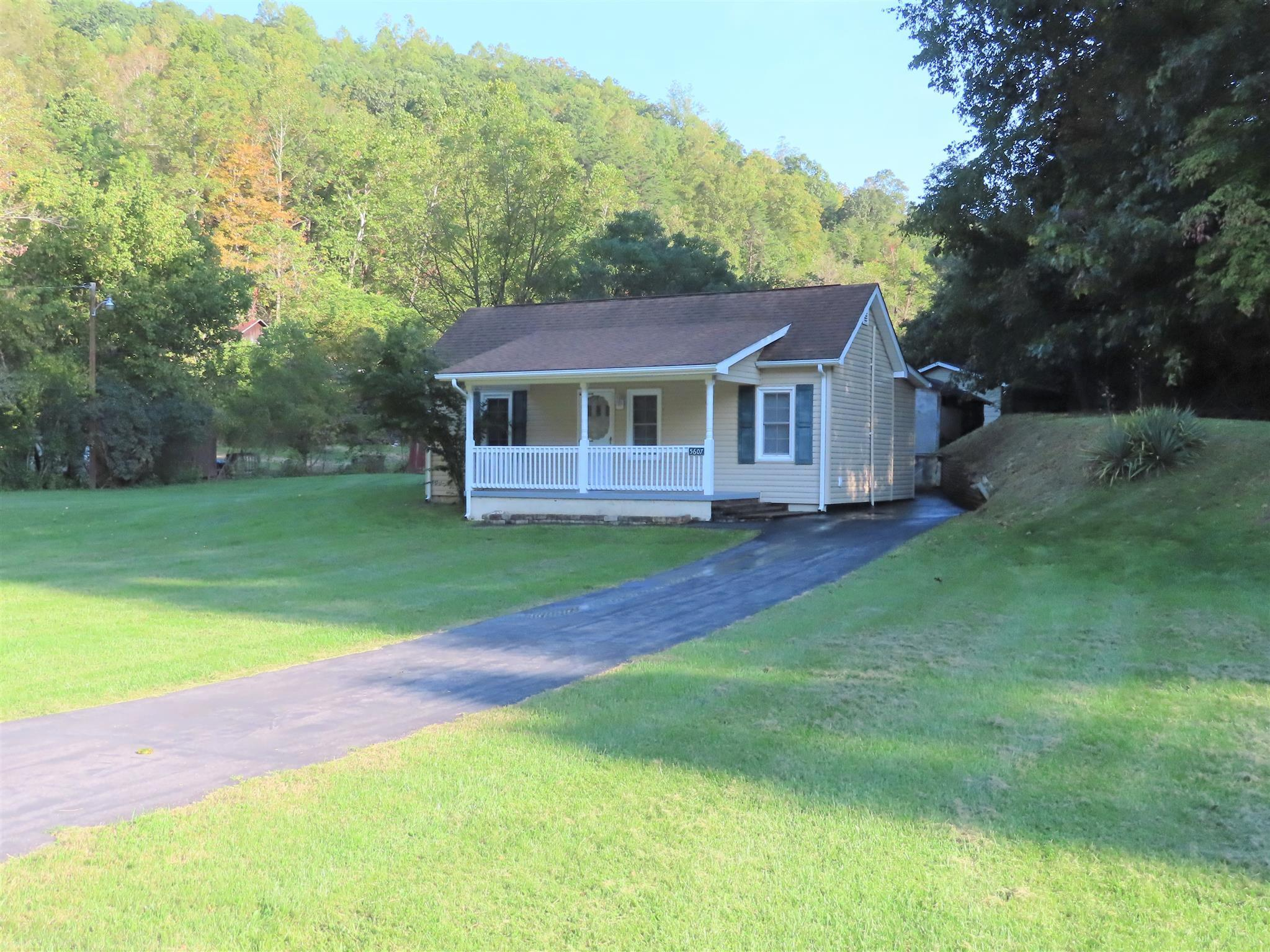 "• 2 BR – 1 BA Sweet Bungalow on .259 Acres • Updated Electrical – Replacement Windows • Paved Driveway – 24'6"" X 16'6"" Garage • Windows & Siding – 10 Years Old • Shingled Roof – 12 Years Old • Large Kitchen With Center Bar • Solid Surface Countertops – Propane Gas Stove • Covered Front Porch – Concrete – Vinyl Railing • Concrete Covered Side Porch"