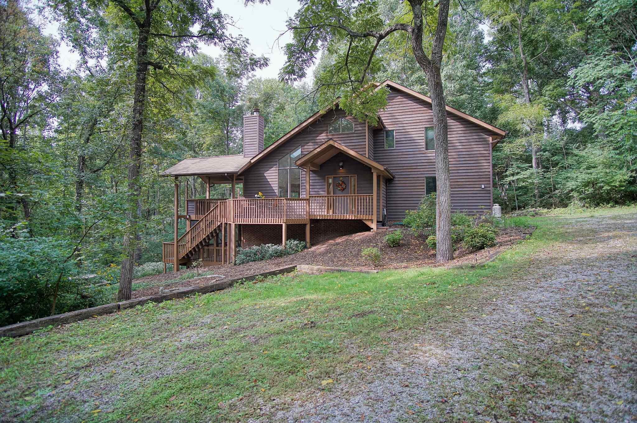 "Bright and spacious 4 BR, 3.5 bath home on over 5 tranquil acres just 20 minutes from downtown Blacksburg.  This contemporary cottage in the unmatched beauty of Catawba Valley offers multiple living areas including the main level living room with new hardwood floors and the basement ""away"" space/family room with new paint that walks out to a private patio from which you can enjoy in tranquility the beauty of nature in the surrounding mature hardwood forest.  The main level flows naturally from the kitchen with custom cherry cabinets and new appliances to the dining and living areas and outdoor spaces including a spacious screened porch. Upstairs hosts 4 bedrooms including one designed with acoustics suitable for a music room.  Two car garage, fenced back yard and paddock and large barn that can function as housing for animals or a shop/vehicle storage area.  Quality construction by Shelter Alternatives with many updates.  Don't miss this beautiful home!"