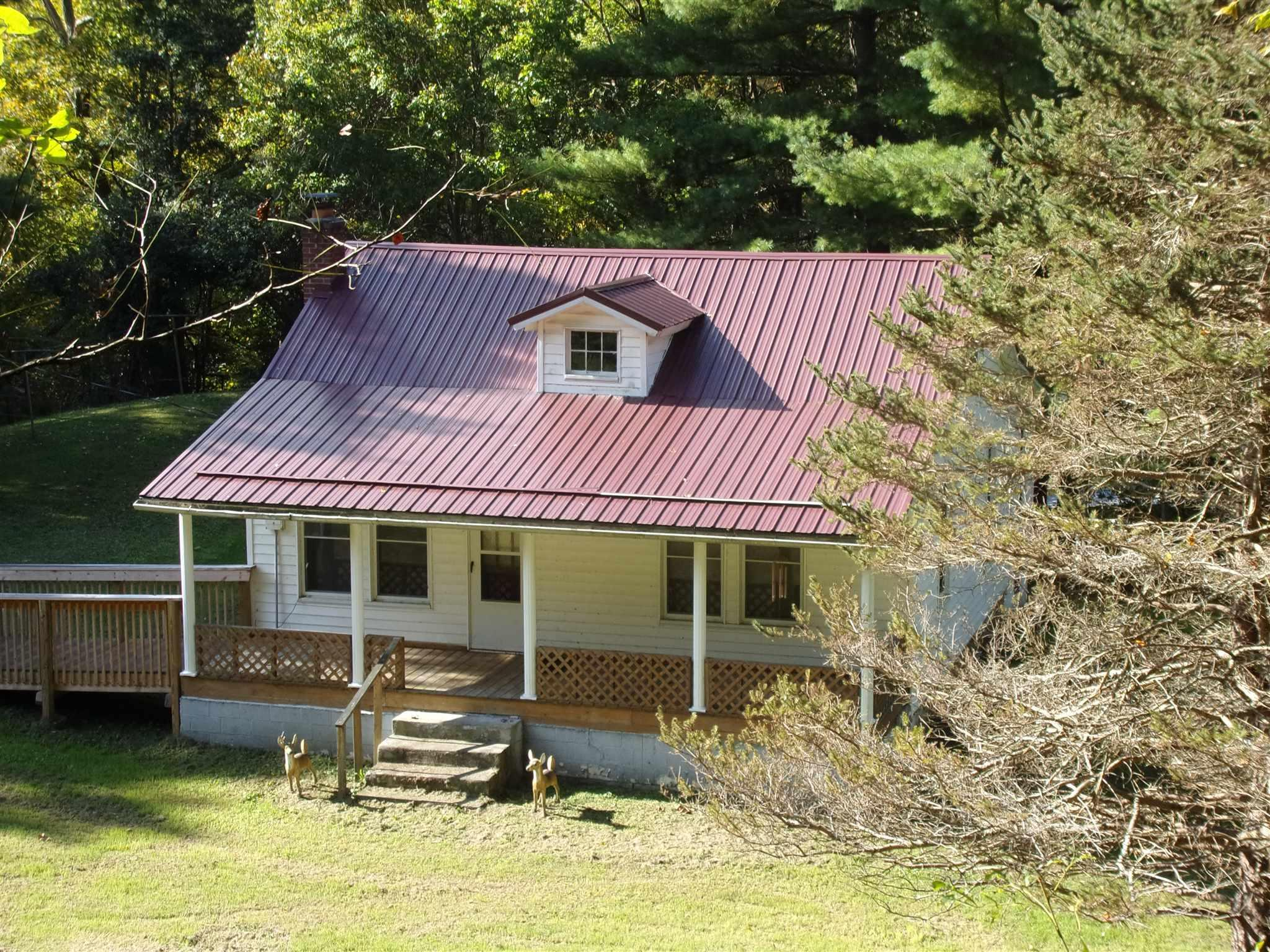 Lovely older home with some updates & lots of Country Charm! Setting on 3ac just out side of town limits, Home has newer HP, Metal Roof, beautiful natural wide base board trim, Updated Electric box & windows large front porch. A Must See!