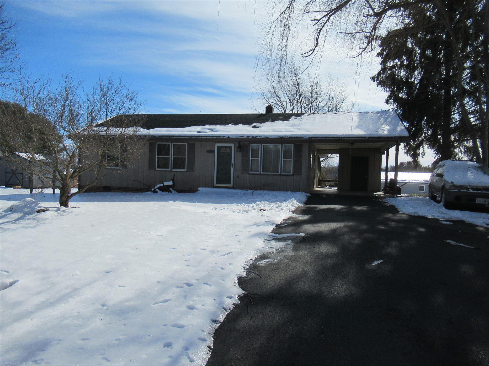 Great location, carport with storage, large enclosed rear porch, nice level lot, home needs a little TLC