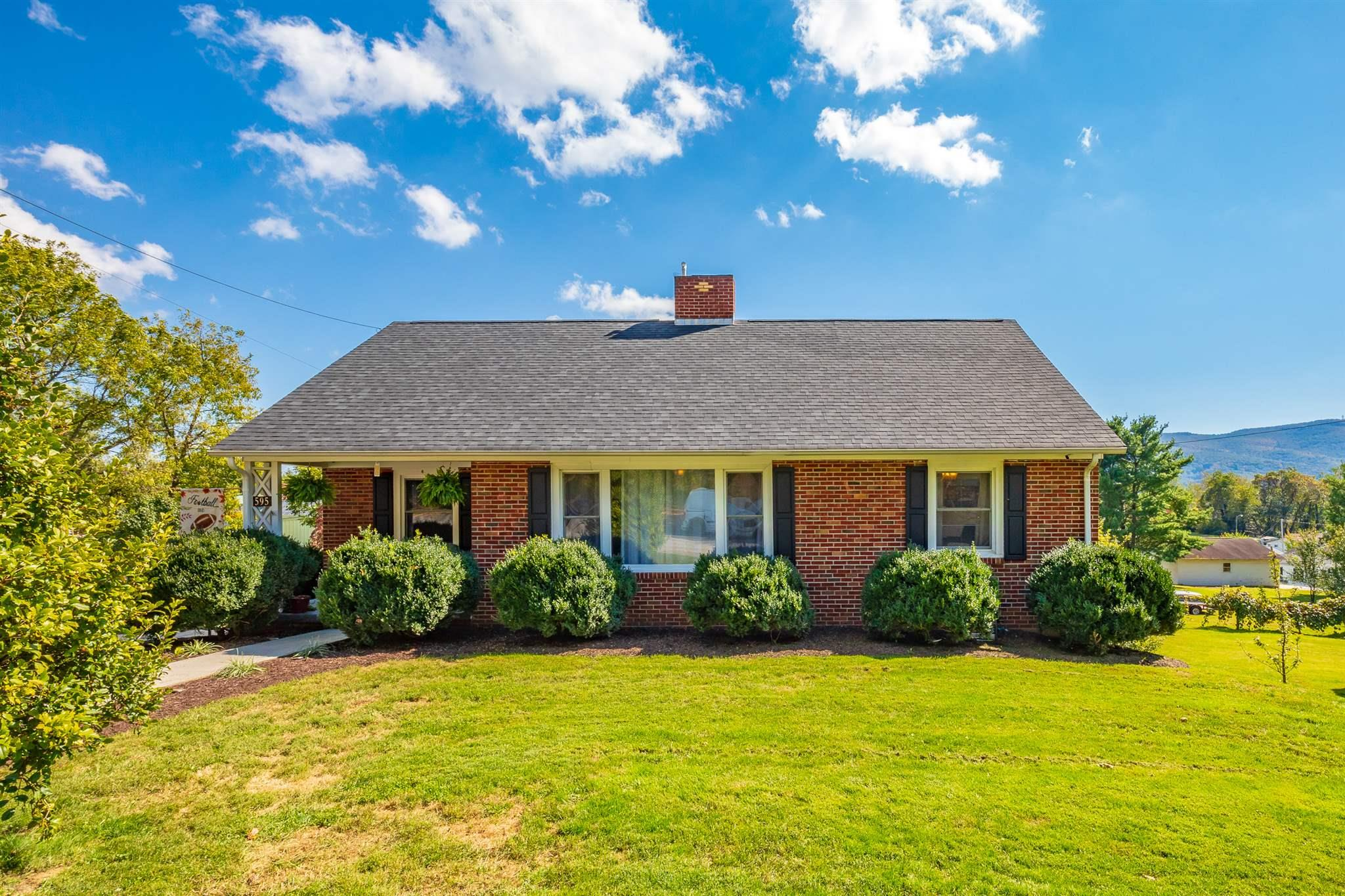 Beautiful brick ranch with excellent views located on an extra large corner lot. This home is loaded with updates in the past 3 years! All rooms with hardwood flooring have been refinished. Painted crown moulding and new fixtures in every room. Kitchen remodel featuring new drywall, tile flooring, cabinets, dishwasher, natural gas stove & built in microwave. Bathroom completely remodeled including sink, flooring, toilet and bathtub/shower. Other valuable improvements consist of an automatic garage door with opener, natural gas water heater, heating and cooling system/natural gas backup heat with a Nest thermostat control and natural gas logs upstairs. Outside..new shutters, professional landscaping, fresh paint on foundation, wired camera security system, home satellite dish Directv ready, and a steel door to basement area. Plus, completely new plumbing throughout entire house. This 3 bedroom 1 bath home is move in ready!