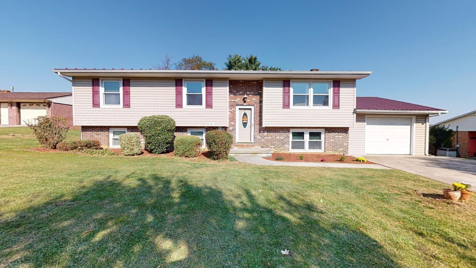 Beautiful split foyer with 4 bedrooms and 2 baths, close to shopping, schools, and hospital.