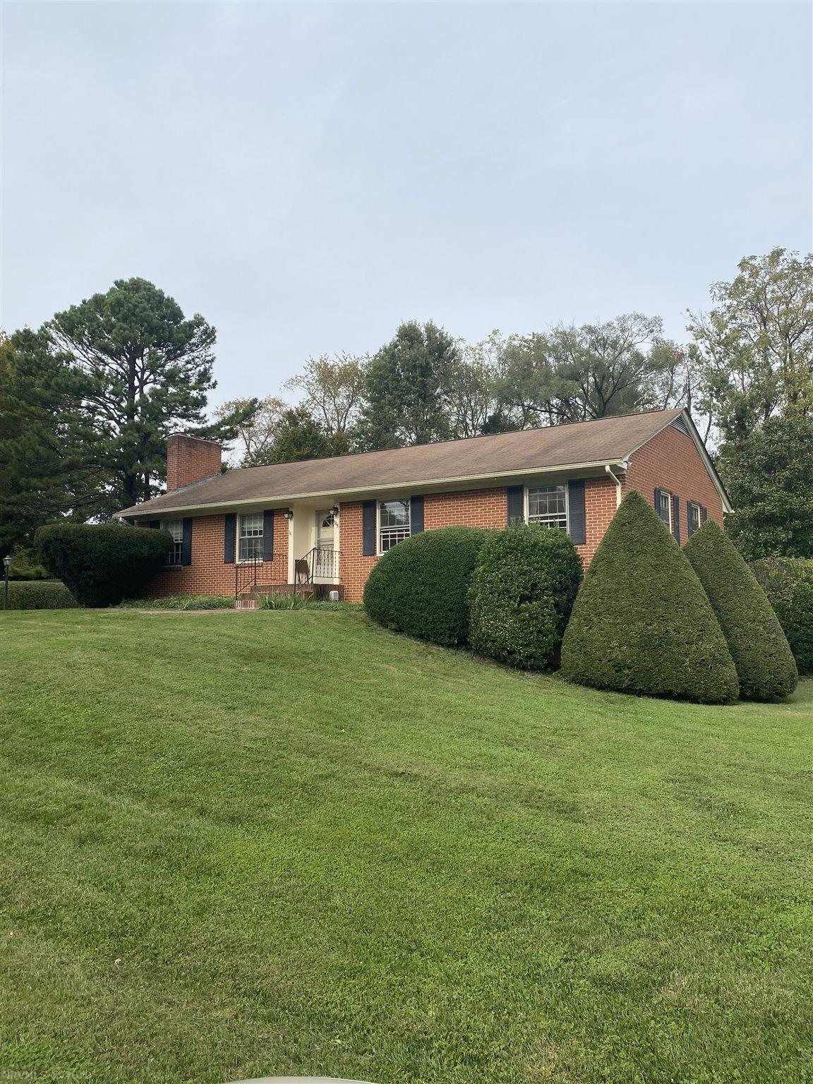 Location, Location, Location.  Close to shopping, campus. not to mention the Huckleberry and Lane Stadium. Hardwood Floors. Built in Bookcases in Living Rm along with Masonry Fireplaces in Formal Living Rm and Basement. Two car attached Carport.