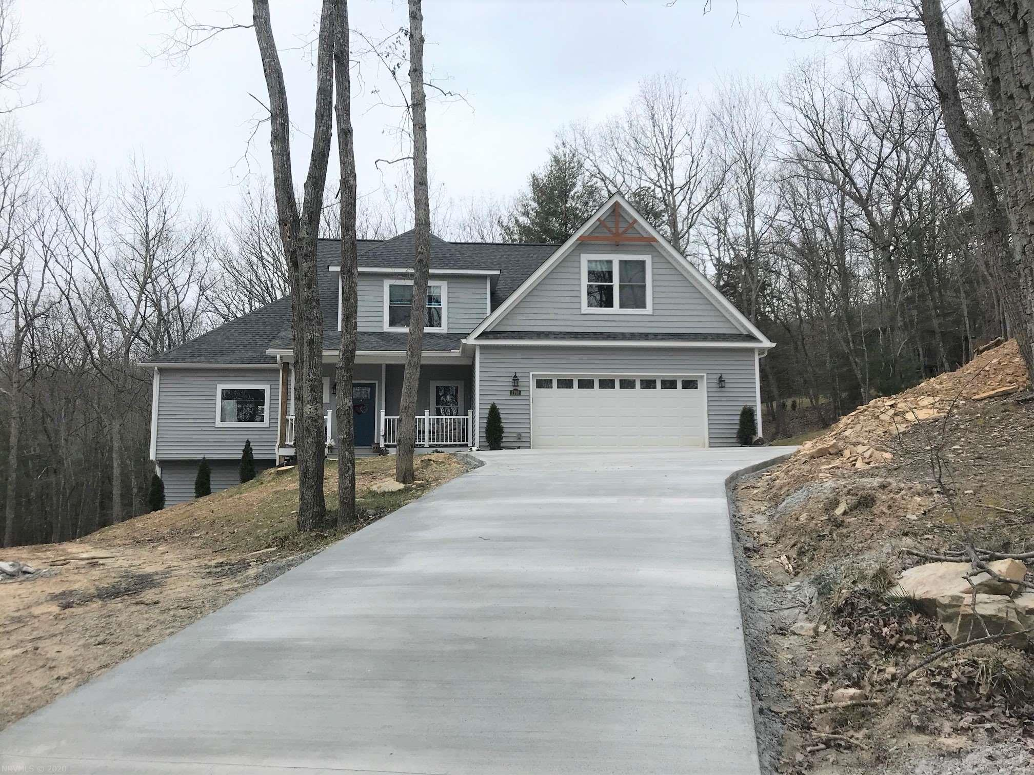 Built in 2019, this contemporary 2 story home is sited on a 3.09 wooded lot in a Blacksburg community just outside the town limits.  The main level is enhanced with flowing hardwood floors,  a family room with vaulted ceiling and gas log fireplace with a vintage mantle.  An open living room, dining area and kitchen concept.  The formal dining room with unique french doors, is presently being used as an office.  Stainless steel appliances and work island in the kitchen.  Off the kitchen you access the laundry room, 1/2 bath & garage. A grand master suite offering a private deck, a walk in closet, & private bath accented by an antique tub, double sinks & ceramic tiled spacious step in shower. Venture upstairs to 3 bedrooms one with private bath & a full hall bath. The full basement basement has a family room w/gas log fireplace, full bath and 2 unfinished rooms for storage or set up your own exercise area. You are just minutes from downtown Blacksburg & VA Tech.