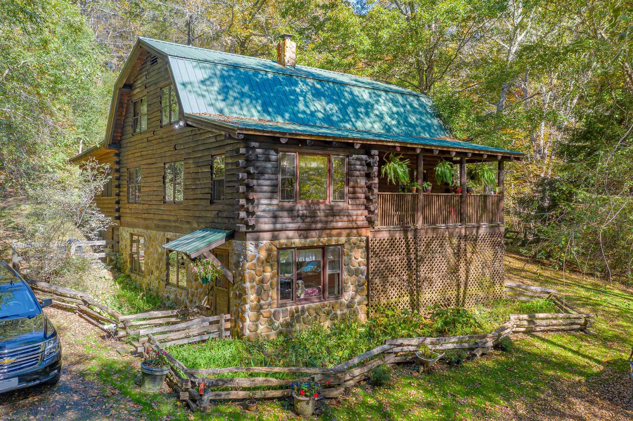 You will love waking to serene living in the Blue Ridge Mountains at this 3 bed, 3 bath cabin. The home rests on 45 acres of land to call your own. The 2582 sq. ft. home features a cozy cabin design that will feel like your personal mountain retreat. You can grill, enjoy a meal, drink a great cup of coffee, and enjoy a tranquil setting on the front porch or back patio. On nights spent inside, you will enjoy the wood burning stove and the finished basement. With 45 acres including some cleared pasture, you can enjoy all the outdoor recreation you desire from hiking and horseback riding, to hunting and ATV riding. The home also includes multiple outside sheds to store everything from tools to gardening supplies and toys, and stables ready for your horses and hobbies. While you can experience the oasis of the mountains, the home is conveniently situated less than 12 miles from Grayson Highlands, 15 miles from Independence, 28 miles to Marion and less than 10 miles to Troutdale.