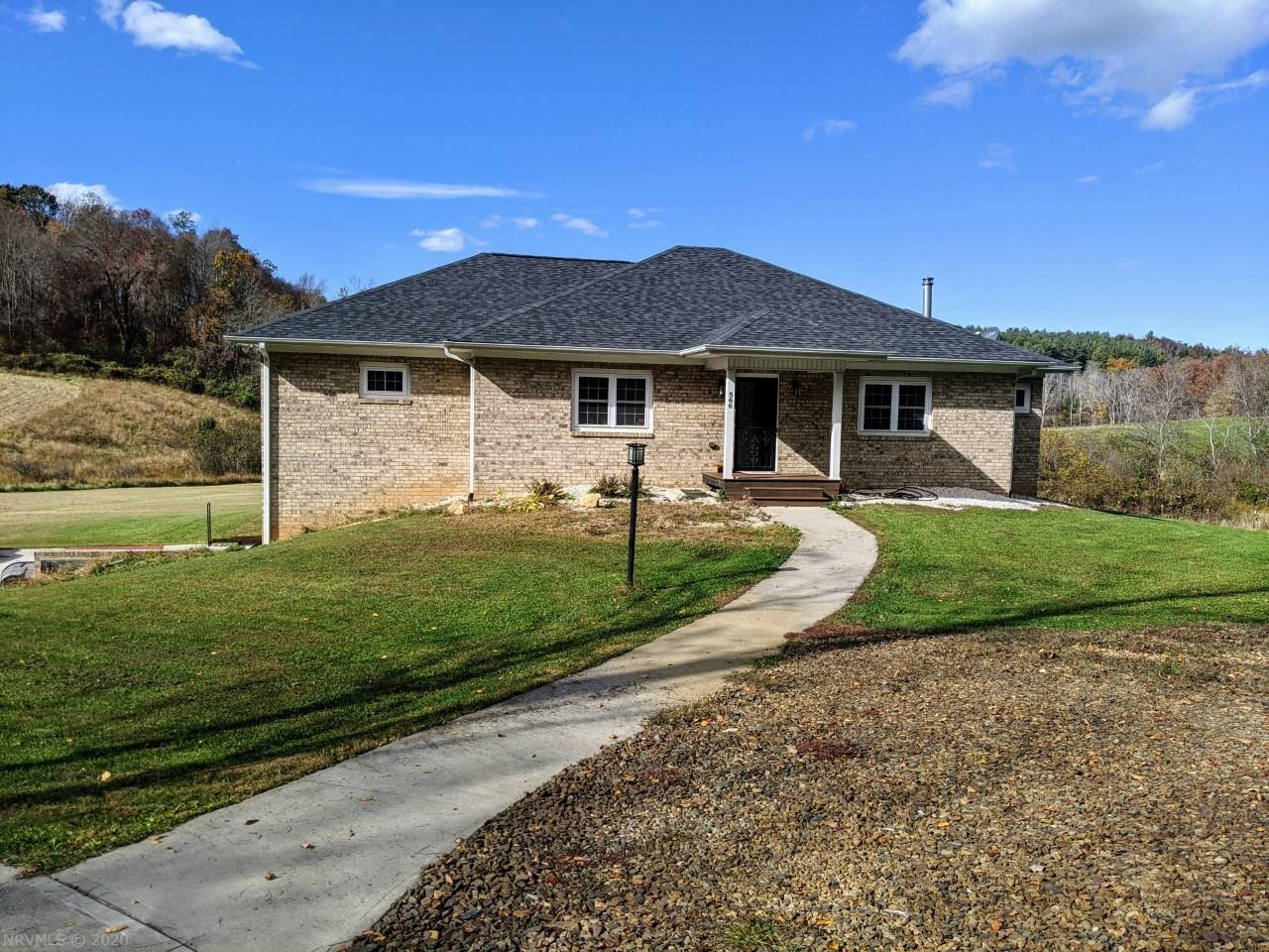 This beautiful 2014 Custom Built Brick Home on 8.54 Acres has it all! This home features 3 BRs & 2 Baths, plus 7x8 Office. Large walk-in closets in the bedrooms. White Oak hardwood Floors cover the 2010 Sq Ft., with Porcelain Tile in bathrooms, laundry room and office. Soap-Stone Hearth for included wood stove. Recessed Lighting and ceiling fans. Beautiful Quartz Counter tops in the kitchen and Marble Counter tops in the bathrooms. Soft close cabinet doors in kitchen. Walk-in Pantry. 3-season room. Full walk-out Basement with a double car garage. Cold storage room. Poured Concrete Walls. Architectural 50 year Shingles. Fenced-in back yard patio. Concrete Driveway. This property is great laying, cleared and wooded with a creek, fruit trees and grape vines. Partially fenced for livestock with two 12x20 shelters. Hook up for whole house generator. Multi-stage water purification system in kitchen. Gas heat and on-demand, gas-fired water heater. Underground 500 gallon tank.