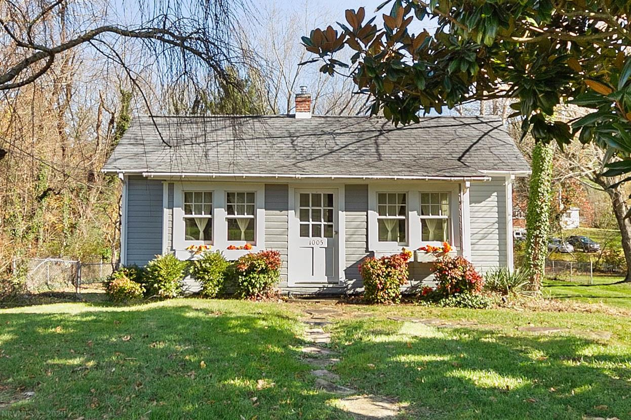 """Charming cottage home in prime S. Main Street area, convenient to everything! Completely renovated in 2008. Main level with  living room, kitchen, sun porch, two bedrooms, one bathroom, plus two-bedroom apartment in walk-out lower level.  The apartment is leased through June, 2021.   Almost half-acre lot, large back yard, and deck with pergola. Plenty of paved off-street parking. Furnishings available for purchase, see  """"D"""" (Documents) icon for list."""