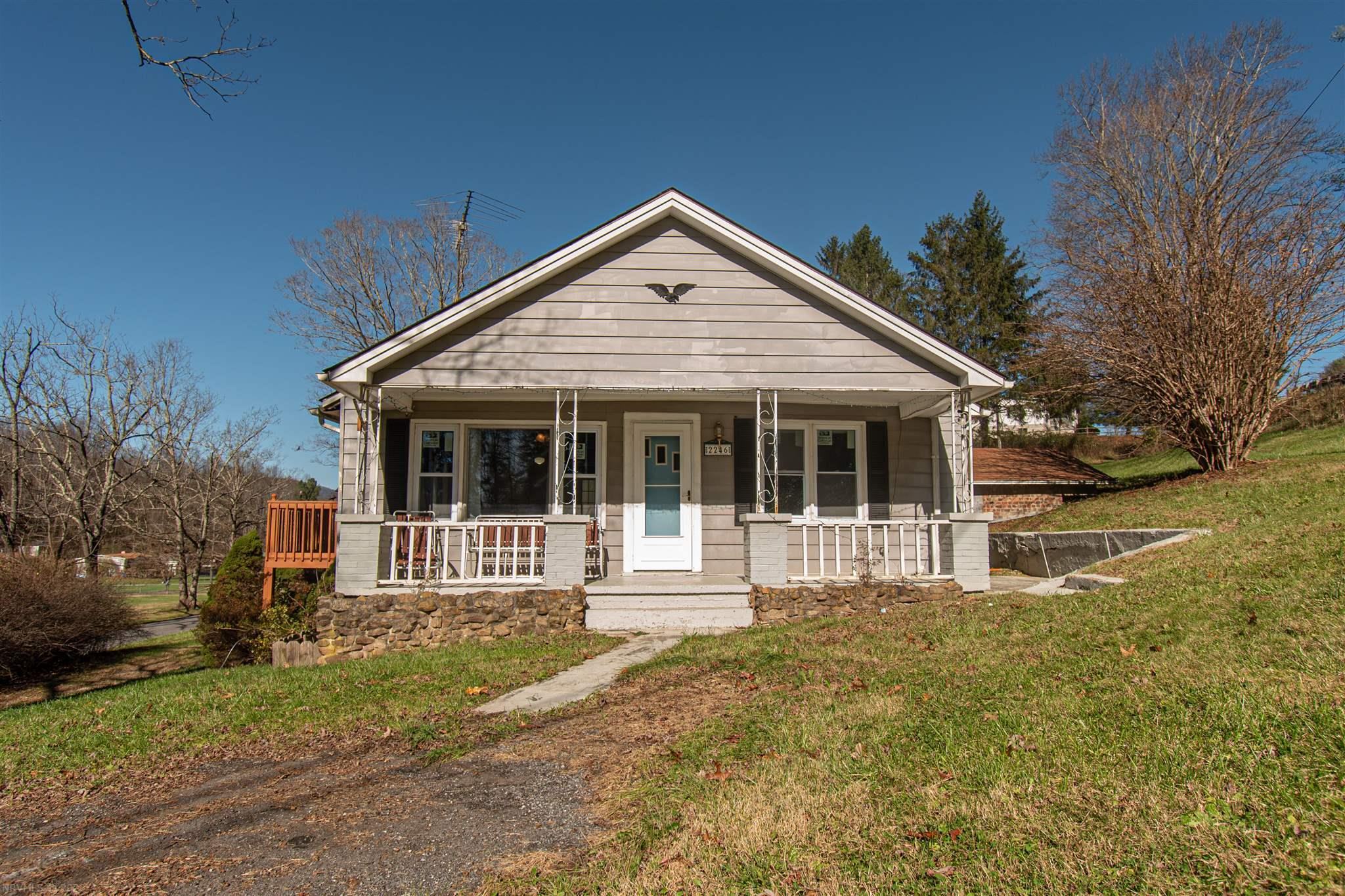 Very cozy cottage in the heart of Hiwassee. This one-level is everything you could want in a first home or rental property. Huge yard with  double detached garage, large deck and gazebo to entertain all your guest. New replacement windows , French doors accessing the front deck and new heat pump.  This home is also 5 minute walk from the lake .