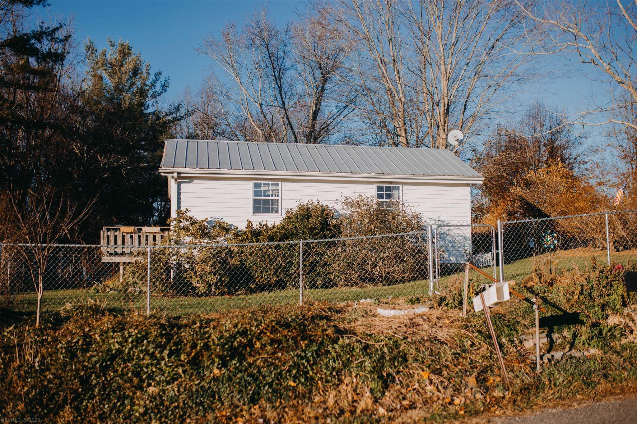 Holiday Handy-man special, this house has a ton of potential. Extra Rooms. Priced to sell, Large lot 3.54 Acres primarily wooded area, some big timber. Storage Building on property. Wrap Around Deck. Could make a great Investment Property. Call Today