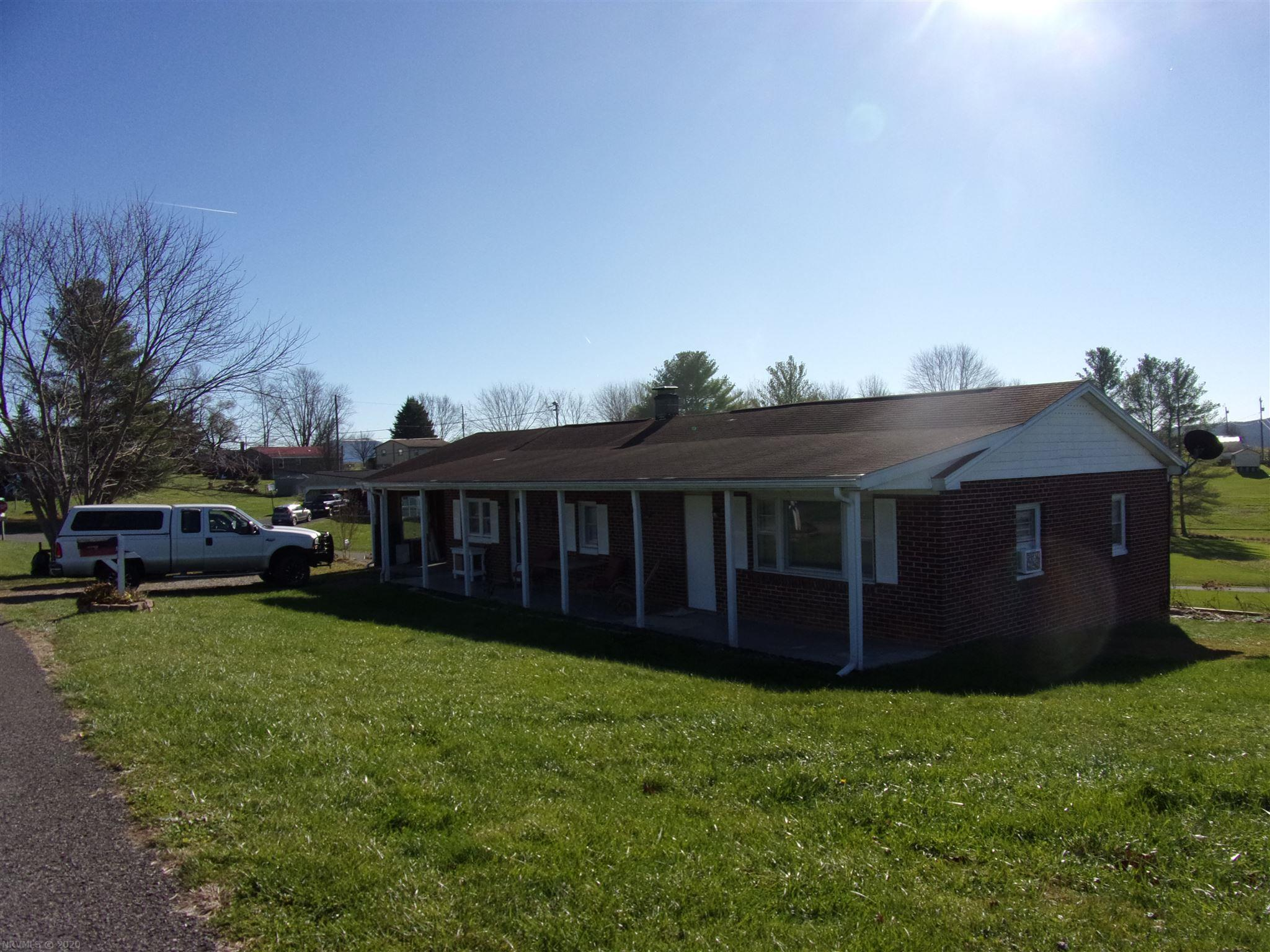 Brick ranch with 2br,1ba,carport, full basement, laundry on the main.  needs a little TLC, Great Corner 2ac lot, Being Sold AS-IS.
