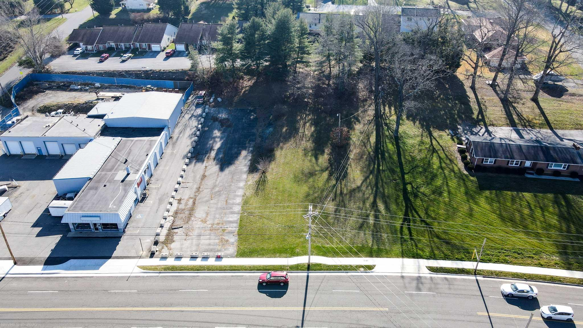 Commercial lot with 164 ft. of frontage on Roanoke St.   Plan your new business from the ground up on this level lot.  VDOT approved entrance recently installed. Town of Christiansburg has completed sidewalk installation. Parking area is included. Concrete barriers along left side will be removed by seller. Temp electric pole has been disconnected, will be removed by seller.