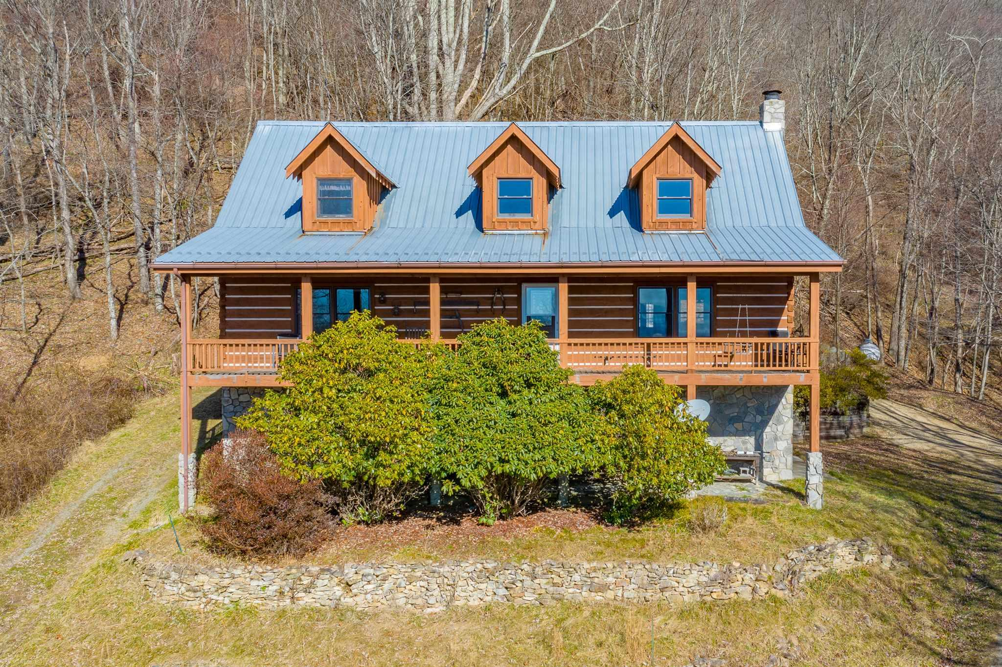 If you've been searching for a secluded log home in the mountains with some land and a view, then you have finally found it! The peace and quiet on the 27+ acres up here is like no other. You have gorgeous long range mountain views year round here. You'll want to spend all day on that front deck. Of course, it is hard to have land and a view in the mountains without doing a little climbing, but don't worry, your car will make it just fine. You have an immaculate 3 bed 3.5 bath home with 2344 SQFT. There is a gorgeous open floor plan with a tall cathedral ceiling. There's a central heating system, a very convenient circle drive that goes around the house, and a 2 car garage that pulls into the basement. Currently, the basement has been used as a shop, but could easily be converted into more living space if you should desire. There is a full bath on each level, to include the basement, plus a half bath on the main level for guest's convenience. You also have a large walk-through pantry.