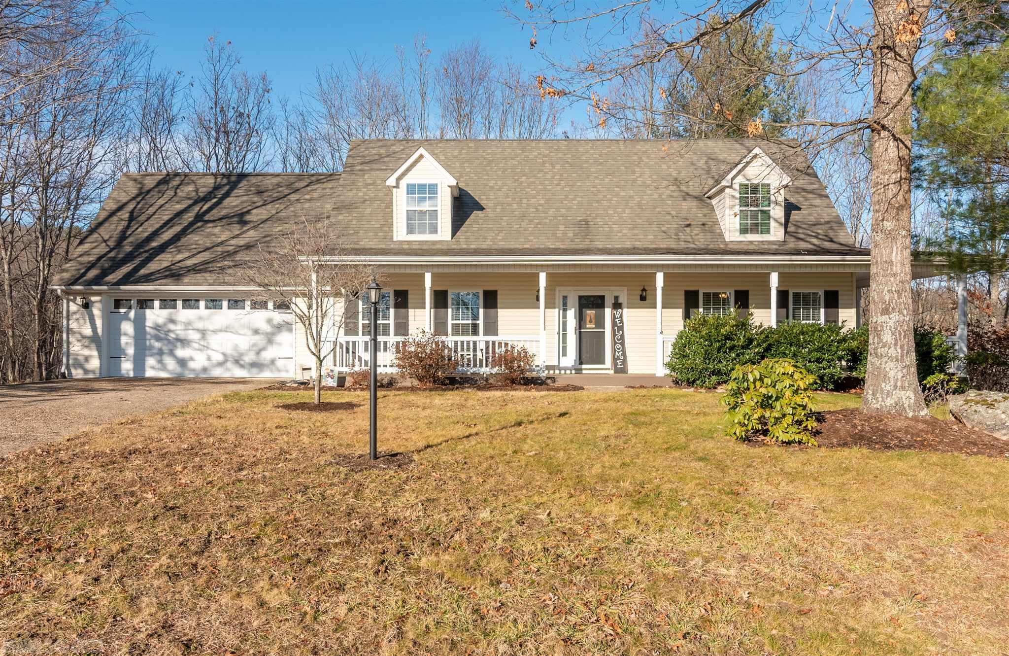 Beautiful, well-maintained Cape Cod home located on 2.16 acres at Brush Mountain Estates. This lovely home boasts a 2 car garage, wrap-around covered porch, and hardwood flooring throughout the main level. Owner's suite is conveniently situated on the main floor along with laundry on the main floor. Upstairs has two spacious bedrooms that feature dormer window seats. Partially finished walk-out basement can serve as an additional recreation room. Storage building located on property. Located within minutes to Virginia Tech. Move in ready!