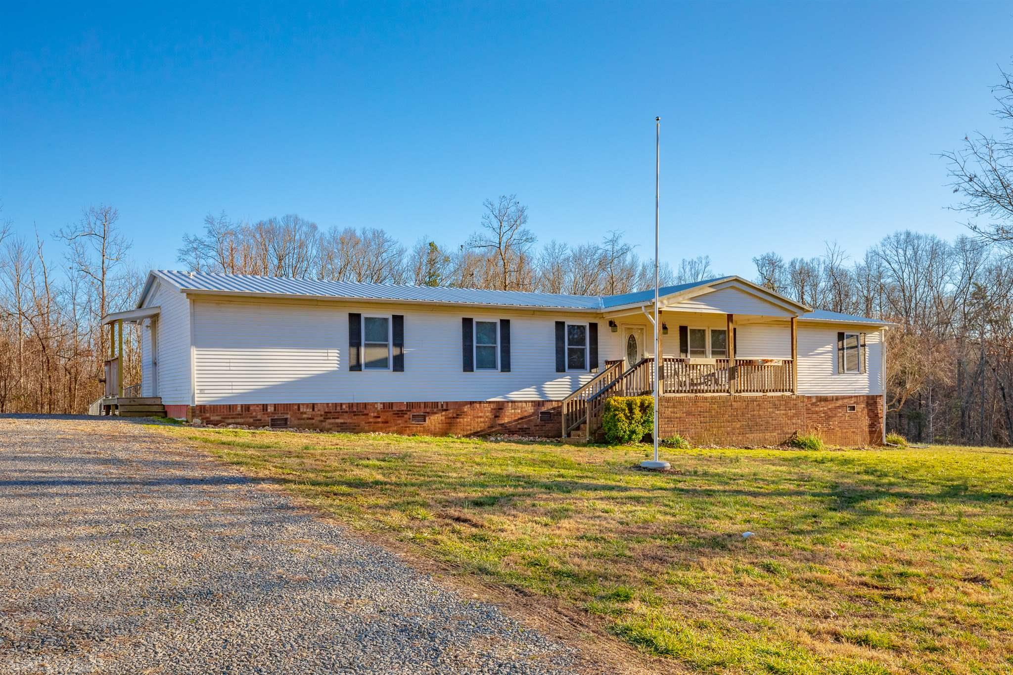 Very nice updated home move-in ready for the entire family with nearly 2.5 acres of flat land. NEW DETACHED 3 BAY 30x40 GARAGE with concrete flooring, 10x10 doors, wood stove included and power to hook up welders and/or compressors. Inside you have newly updated kitchen with soft close cabinets, granite countertops, tile backsplash and new flooring. Eat in kitchen as well as a formal dining area. Newly remodeled master bath with standup shower and walk in master closet and a linen closet, newly updated second bath with full size tub. New flooring in nearly every room. All new insulated windows with single screens. New metal roof in 2018. Cable and high speed internet! Outside a wooden play set with play house and also a patriotic flag pole in front of a covered porch. Under the home you have pipes protected from freezing in the event the weather drops below 39 deg. it automatically comes on to heat up the area. Out back there is a chain link fence with gate to keep your animals in.