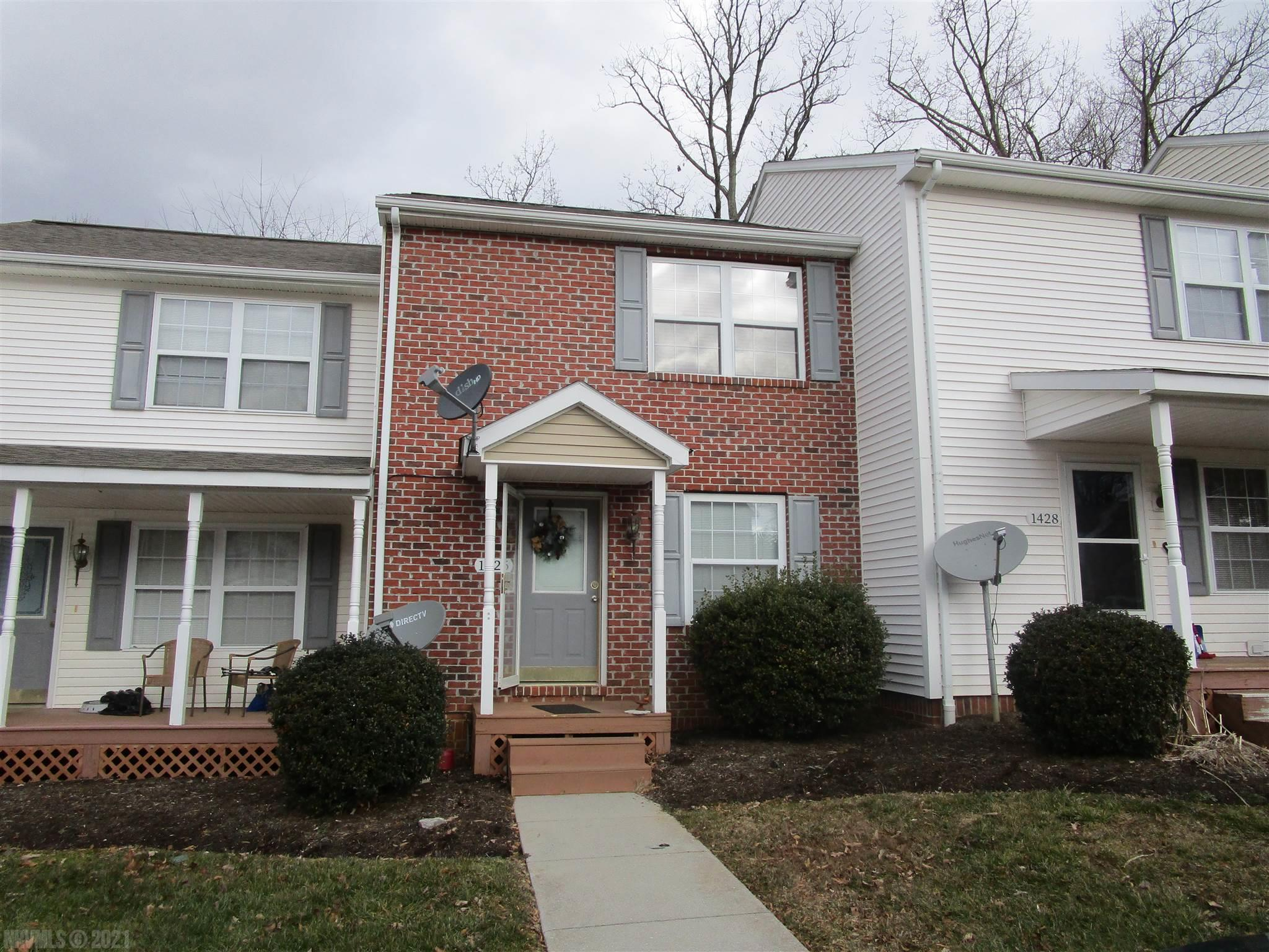 This Beautiful 2 Bedroom 1.5 Bath Home  Is situated right in the Heart of Christiansburg. Close to Food and Shopping and alot of the  Local Attractions. This Town Home has a Brick front and a Concrete Walkway right from your Parking spot in the Front. The Back of the Town Home has a Private Back Deck. The Town Home has a Heat Pump and is Move in ready. Inside on the Main Level. You have a Living Room with New Laminate Flooring, you have a dining room, a Kitchen with Newer Stainless Appliances a Half Bath off of the Kitchen and a Laundry area with a newer washer and Dryer. Upstairs you have 2 Big Bedrooms with Many closets and a Full Bathroom. Come By and Check out this Town Home Today. It won't last long.