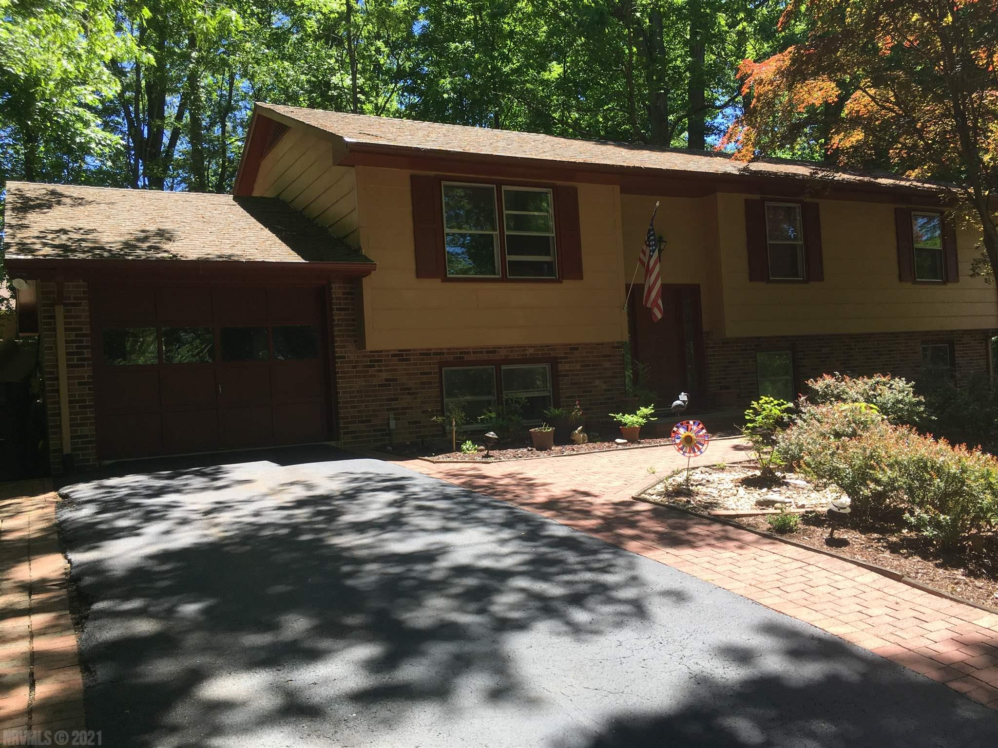Well cared for split foyer home in quiet, mature, wooded Crestwood Gardens.  Convenient to Nellies Cave Park, First and Main, and Virginia Tech.  Deck has separate rear patio with fire pit.  Home has updated appliances, lots of storage, hardwood floors, fresh paint, and on a dead-end street.