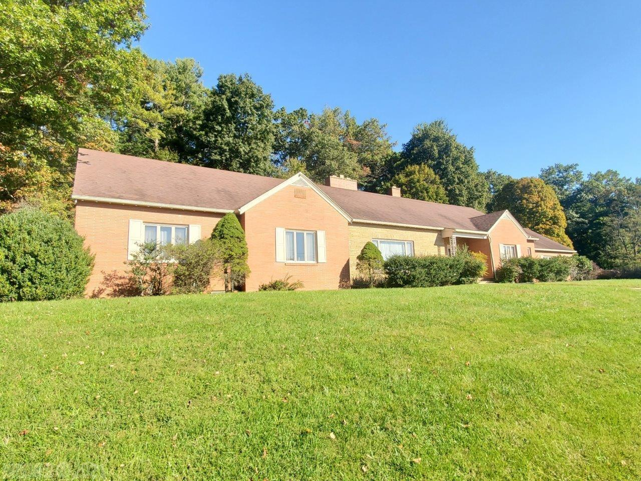 This 1950's showplace has 3 bedrooms and 2.5 bathrooms, 4 fireplaces, beautiful wood trim and floors. 3.475 Acres and paved driveway. Outdoor picnic shelter with fireplace, garden shed, playhouse.