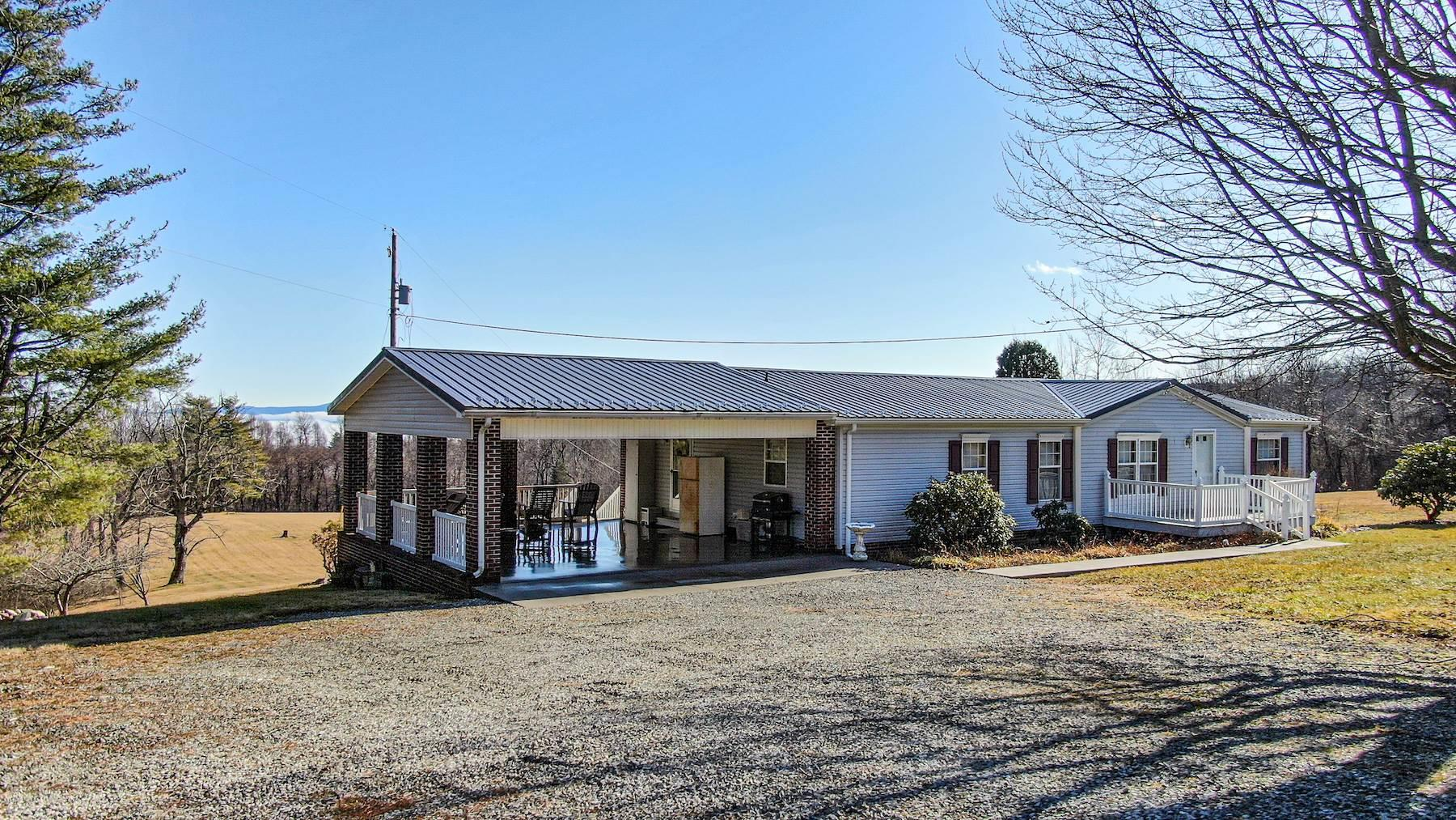 Well maintained home for sale in Floyd VA! This Fleetwood mobile home features 3 bedrooms, 2 baths and a spacious open floor plan. The home has a gorgeous stone fireplace with gas logs. The large master bedroom has plenty of space and has its own master bath with a large bathtub, shower and his & hers sinks. There are two other bedrooms on the other end of the home along with another full bath. Check out the amazing view from the sitting area. Access the back deck from the sliding glass doors. This is an excellent area to kick back after a long day. The kitchen is very clean and has been well kept and has a nice sized pantry for storage. This beautiful home is settled on over 13 acres of land with a huge field and mountain views! Make an appointment to check out this property today!