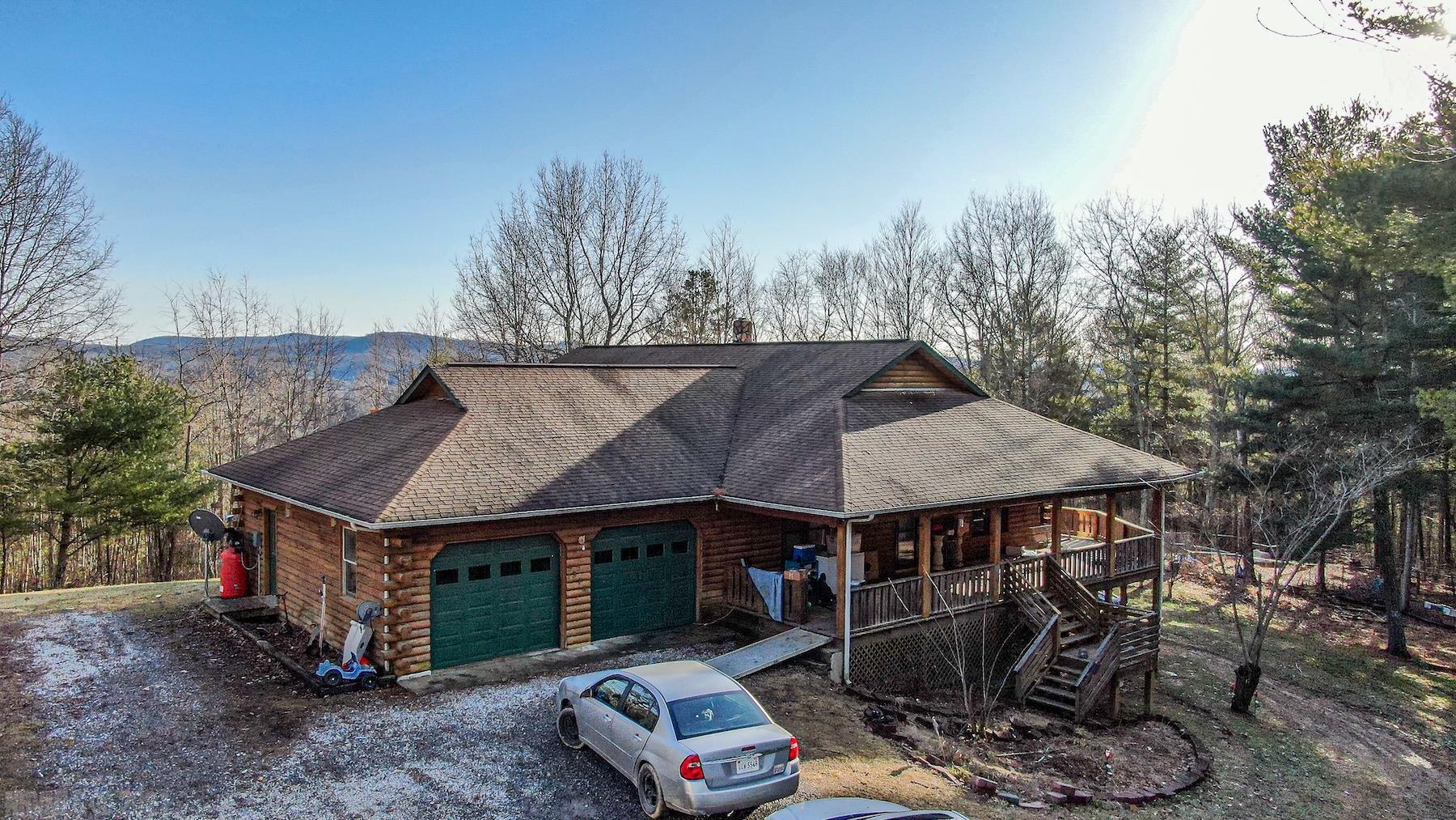 Log Home for Sale at Online Only Auction! Preview Dates- Saturday March 6th @ Noon & Friday March 12th @ 4 PM. Bidding Ends March 18th @ 3 PM. This home features 4,000 sq. ft. with 6 bedrooms and 3 full bathrooms. There are 2 levels, a main level and a basement. The basement is 2,000 sq. ft. and has 3 bedrooms, 1 full bath and 2 kitchenettes. Perfect for use as a mother-in-law suite. On the main level, there are 3 bedrooms and 2 bathrooms. The laundry is located on the main level as well. The home is on a private well, private septic and has a heat pump. There is also a gas log fireplace in the living room. This home has a fabulous covered, wrap around deck and the potential for an amazing mountain view. This property consists of 2 parcels combined to equal 9.16 +/- acres. The surrounding acreage is mostly wooded and is great for recreational use and privacy! Harvest Road is a shared drive and is privately maintained.